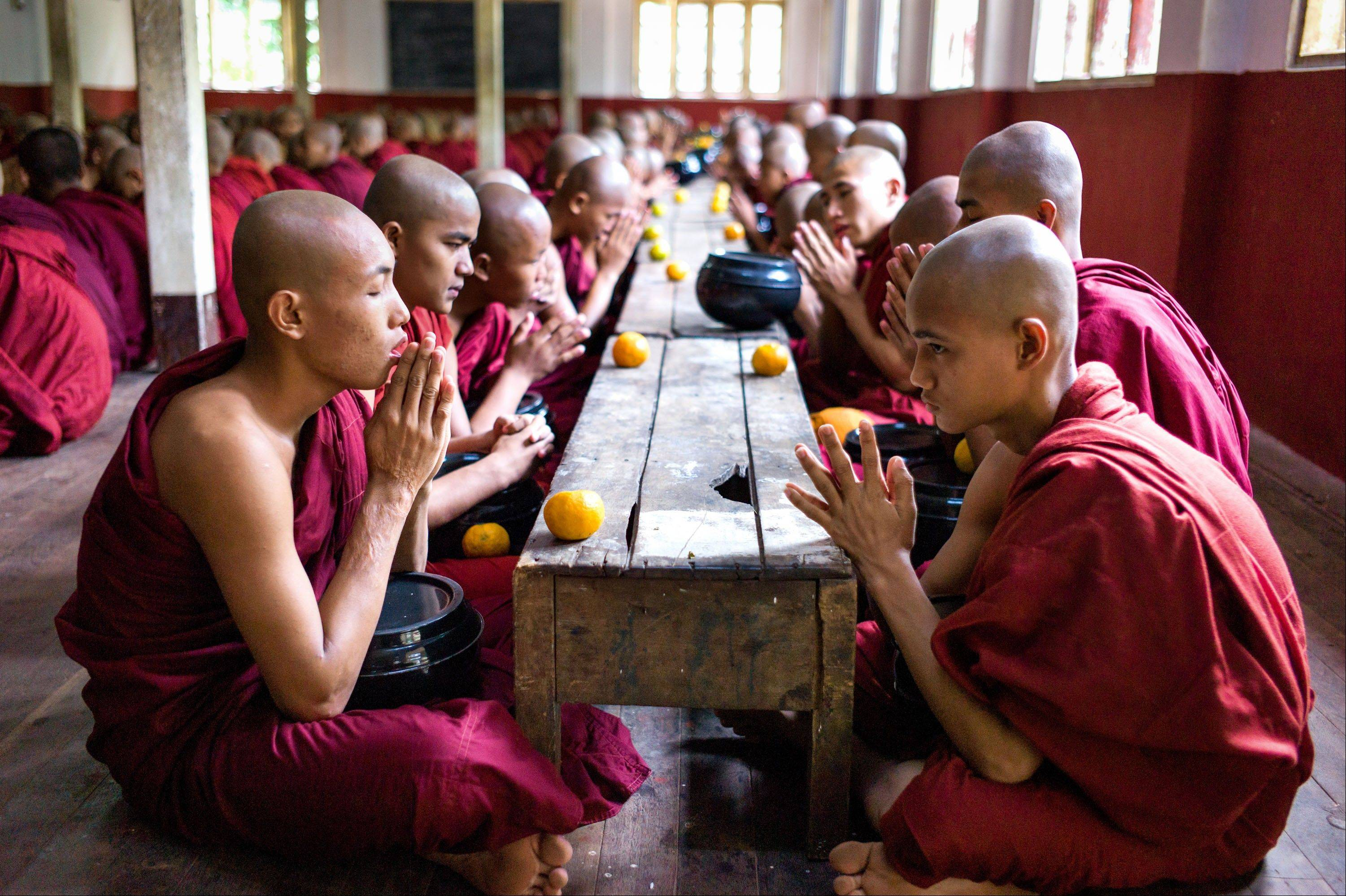Monks pray before eating at the Buddhist Kaleywatawye Monastery in Yangon.