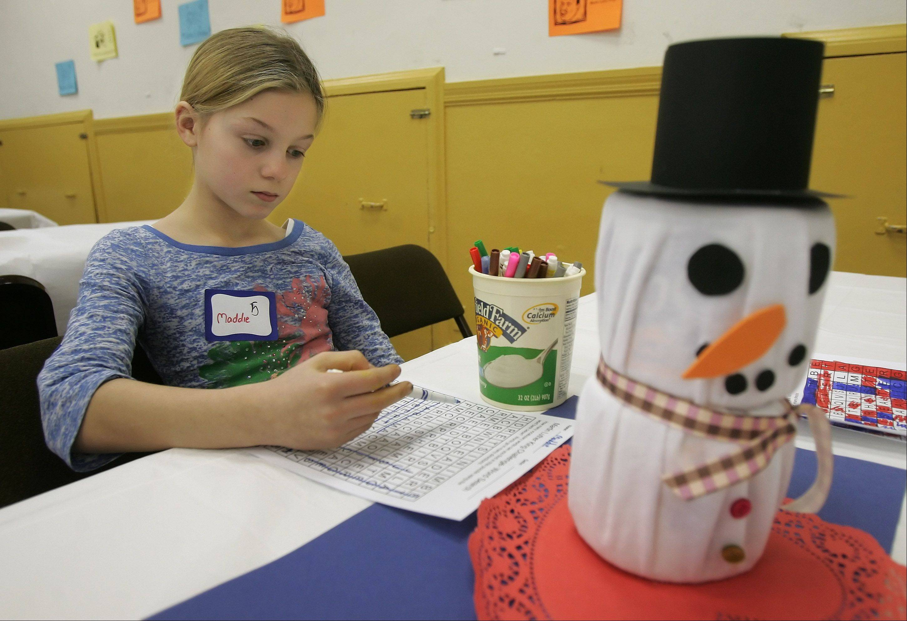 Maddie Kuntz, 10, of Libertyville, works on a word game based on Martin Luther King, Jr. during the Hearts the Same program Monday at the First Presbyterian Church of Libertyville. The event focused on Martin Luther Ling, Jr. with art projects for kids.