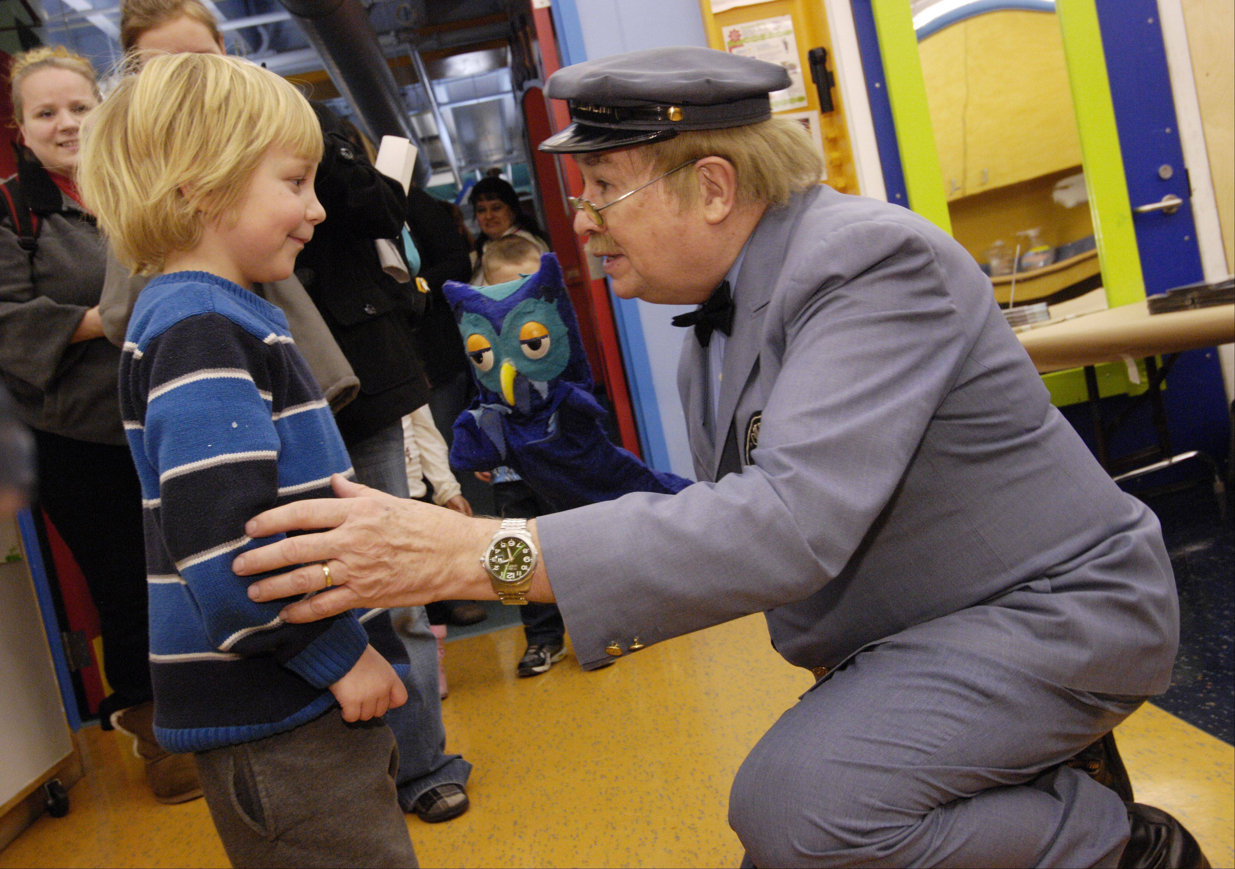 "Mason Beckemeire, 5 of Naperville meets David Newell, ""Mr. McFeely"" the Speedy Delivery man from the children's TV show ""Mr. Rogers' Neighborhood"" and X the owl at the DuPage Children's Museum during a kick off a sweater drive, Sunday."