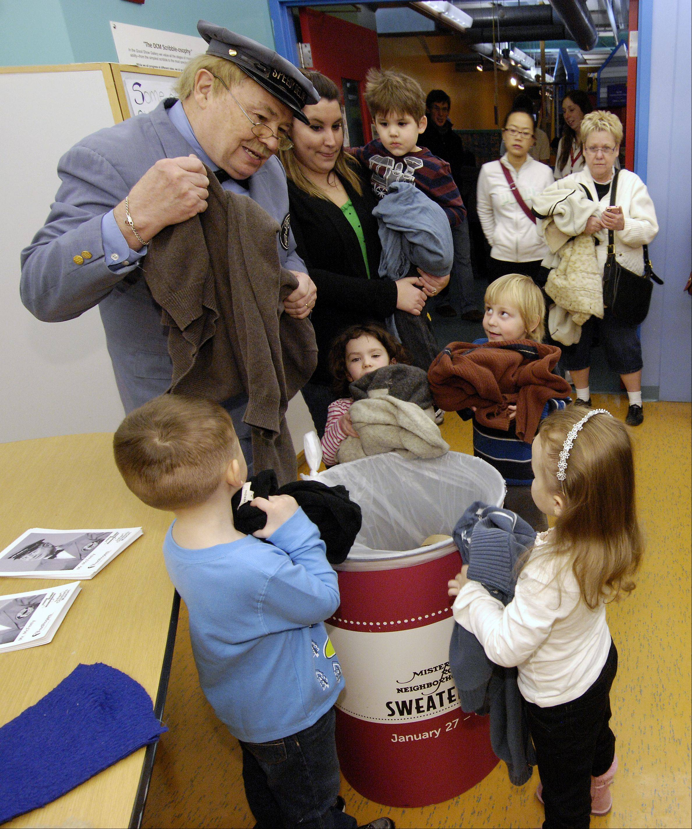 "David Newell, ""Mr. McFeely"" the Speedy Delivery man from the children's TV show ""Mr. Rogers' Neighborhood"" talks to kids about donating sweaters during a visits at the DuPage Children's Museum to kick of a sweater drive, Sunday."