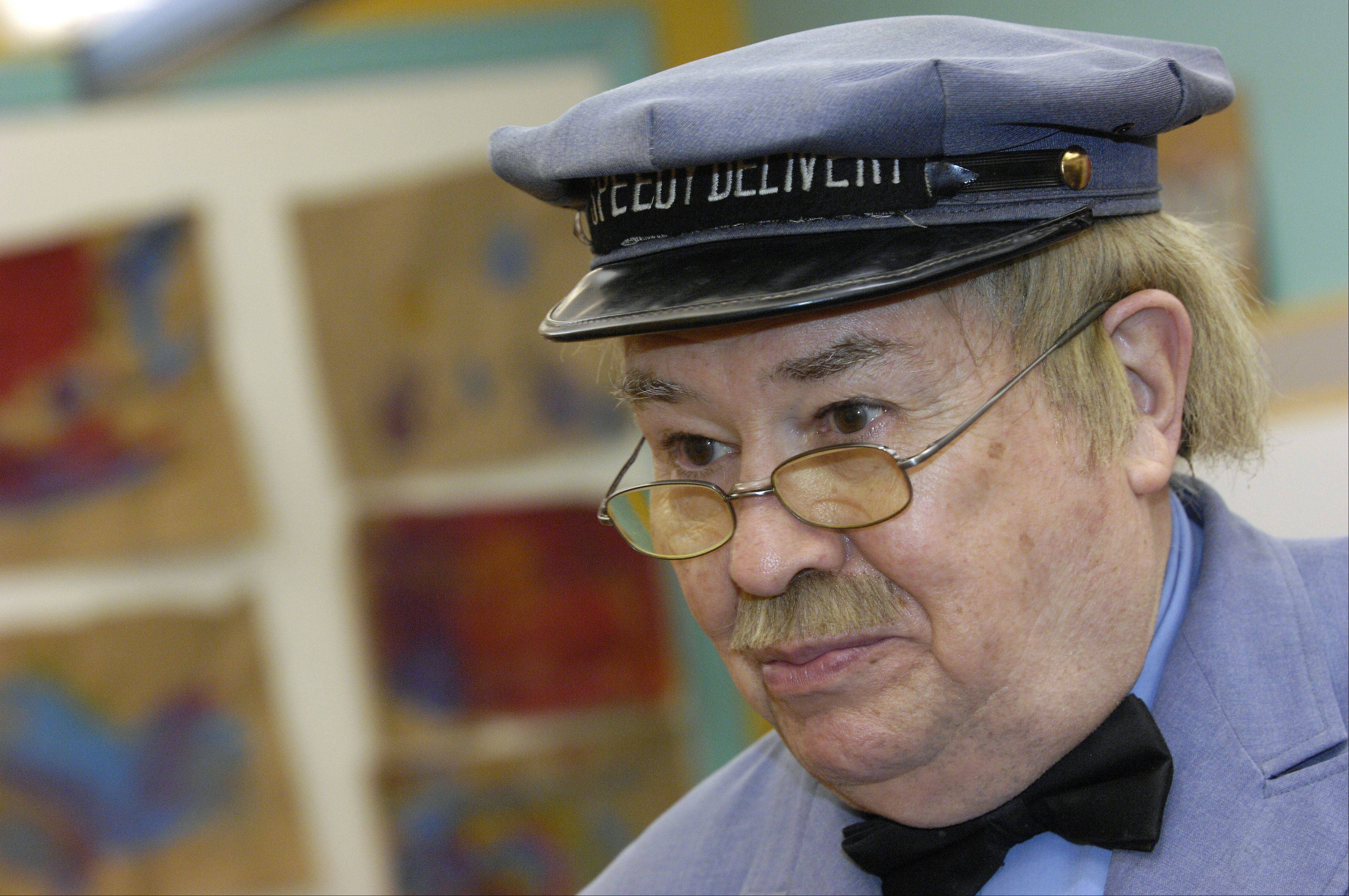 "David Newell, ""Mr. McFeely"" the Speedy Delivery man from the children's TV show ""Mr. Rogers' Neighborhood"" signs autographs at the DuPage Children's Museum to kick of a sweater drive, Sunday."