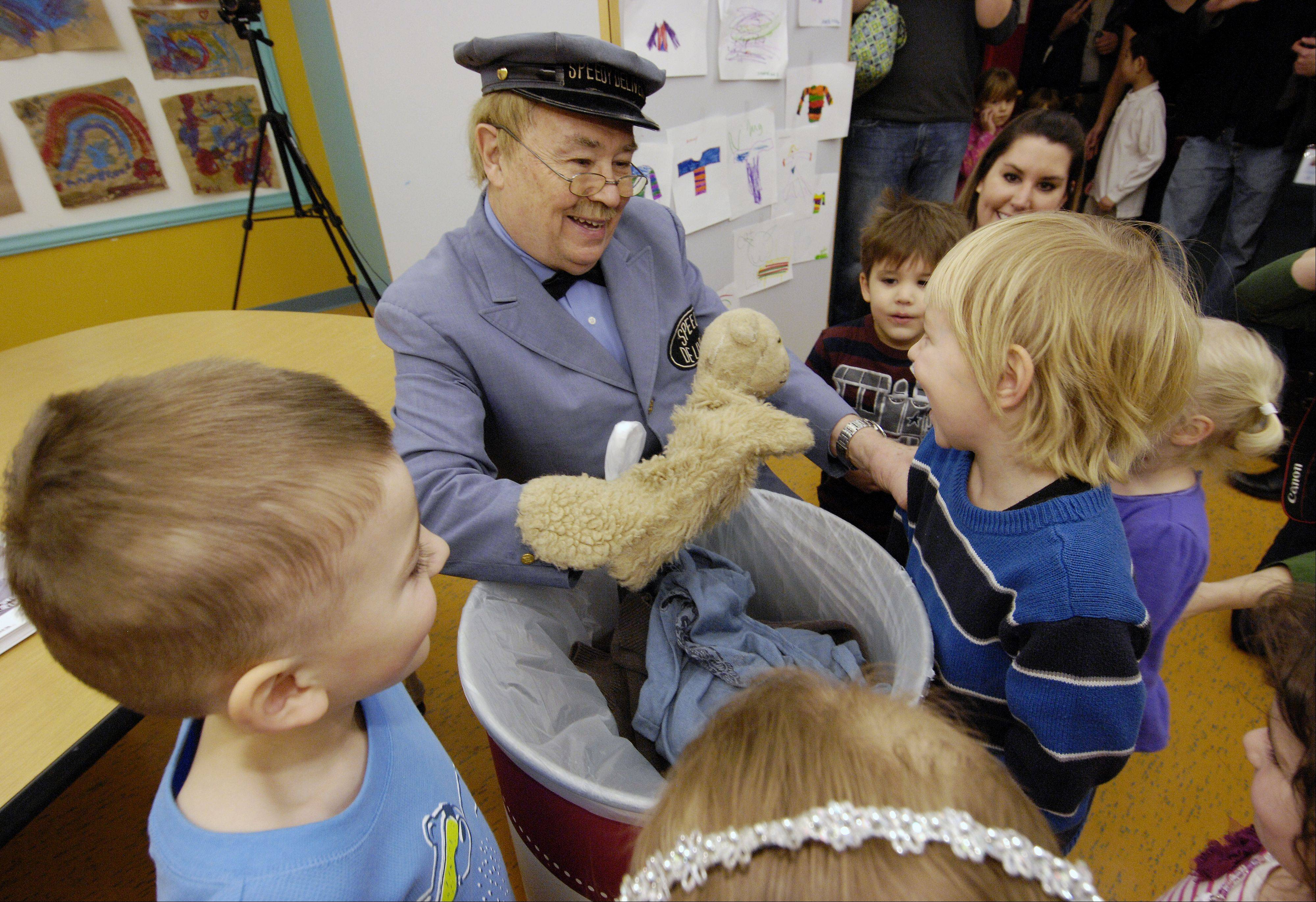 "David Newell, ""Mr. McFeely"" the Speedy Delivery man from the children's TV show ""Mr. Rogers' Neighborhood"" with one of the original puppets ""Daniel Tiger"" visits with children at the DuPage Children's Museum to kick of a sweater drive, Sunday."