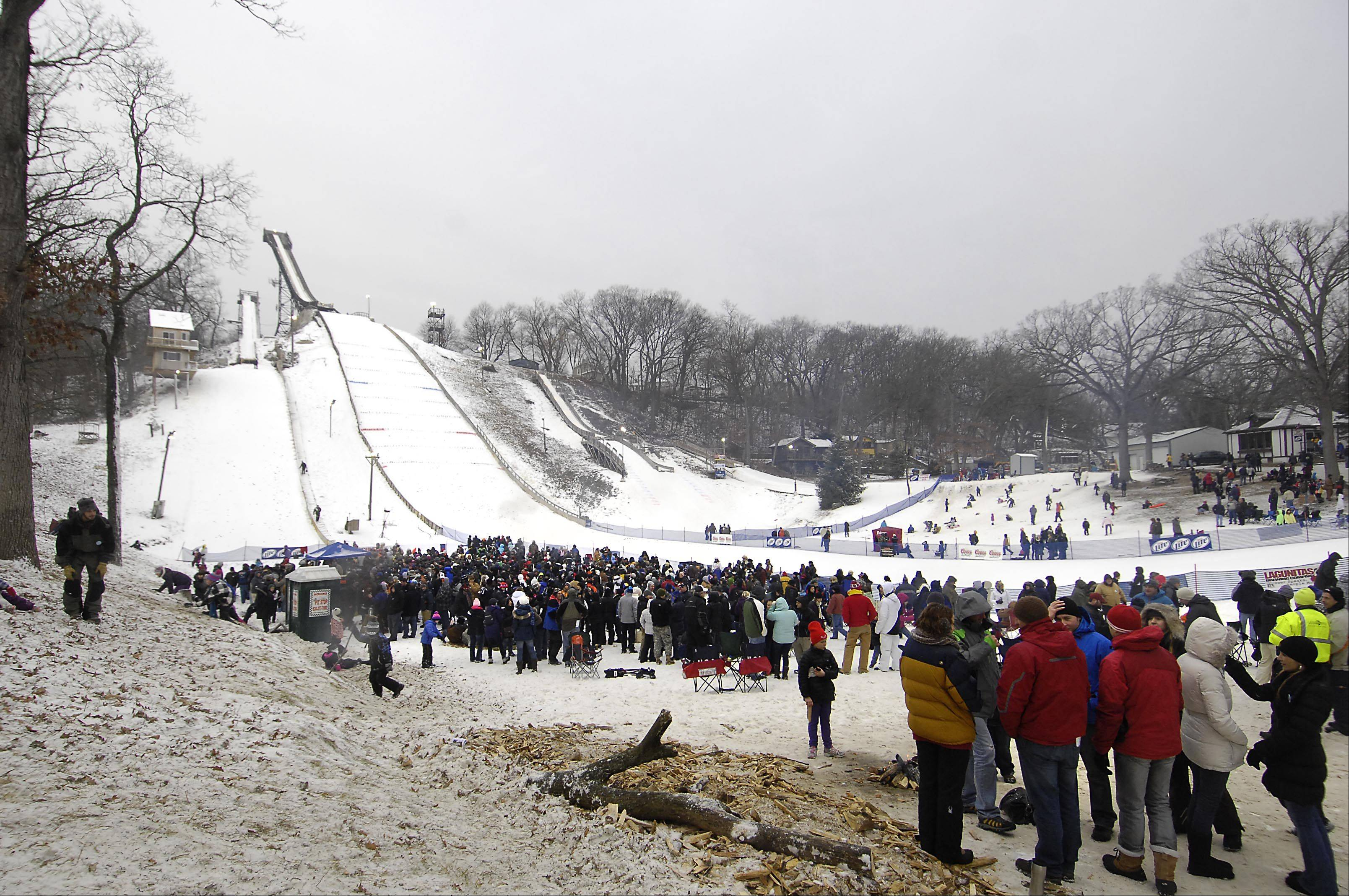 The bowl at the bottom of the hill stayed packed with spectators Sunday at the 108th Annual International Ski Jumping Tournament at Norge Ski Club in Fox River Grove.