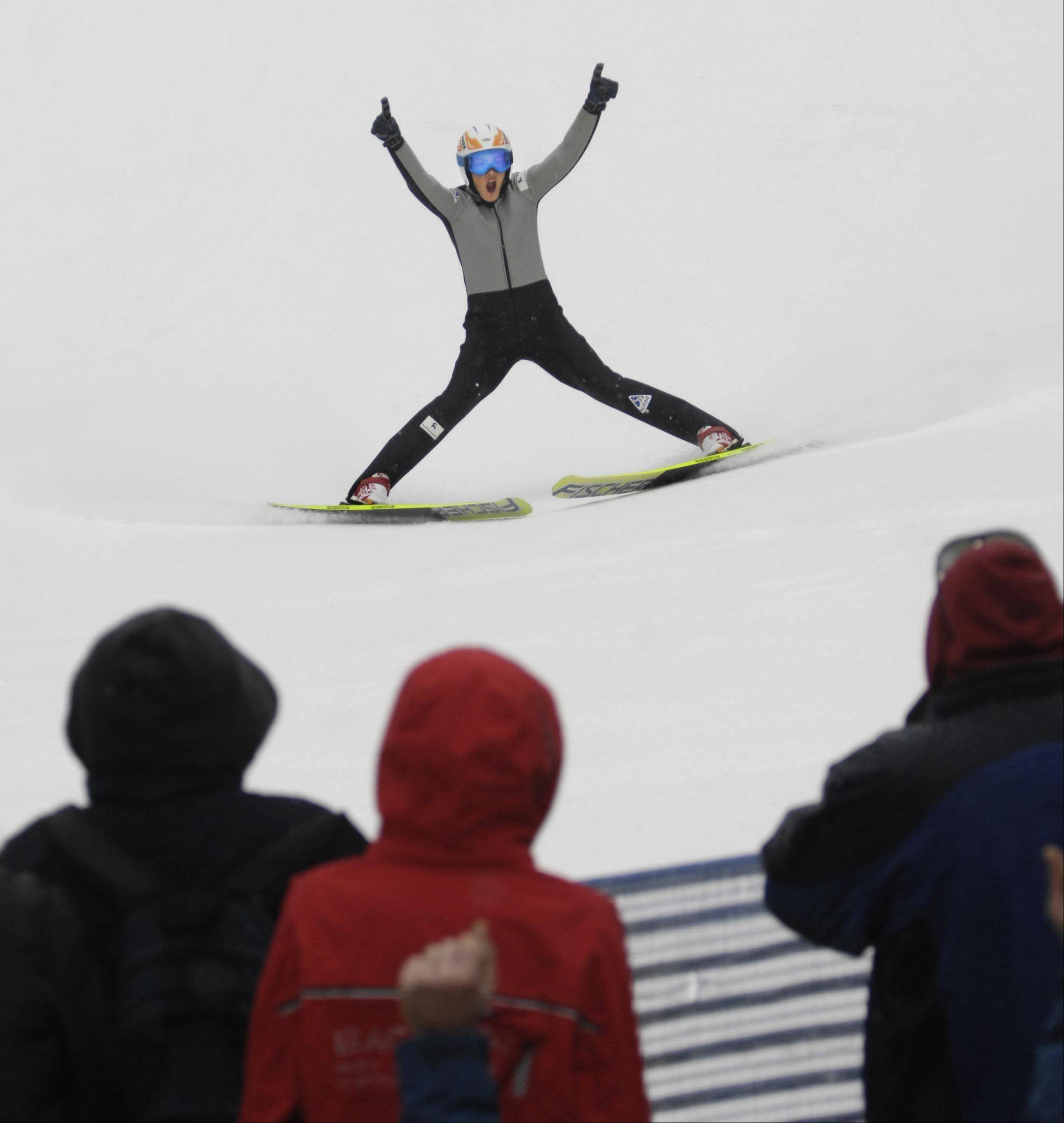 As he comes to a stop at the bottom of the hill, Miles Lussi of Lake Placid, N.Y., exalts in his 78-meter jump Sunday at the 108th Annual International Ski Jumping Tournament at Norge Ski Club in Fox River Grove.