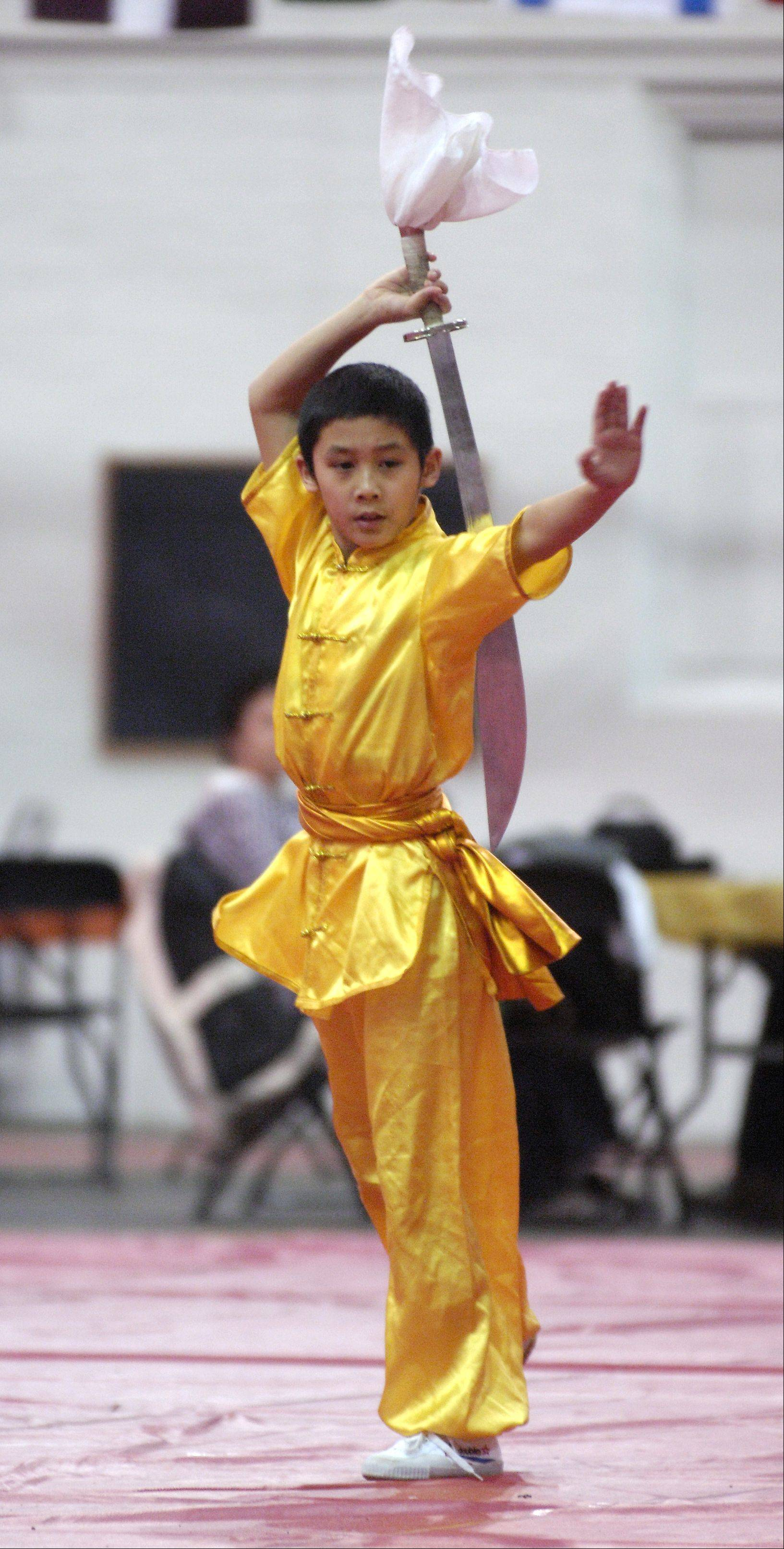 Penwille Chen, 10, of Woodridge performs Shaolin Kung Fu on Sunday during North Central College's 17th annual International Festival in the Naperville college's Merner Field House Naperville.