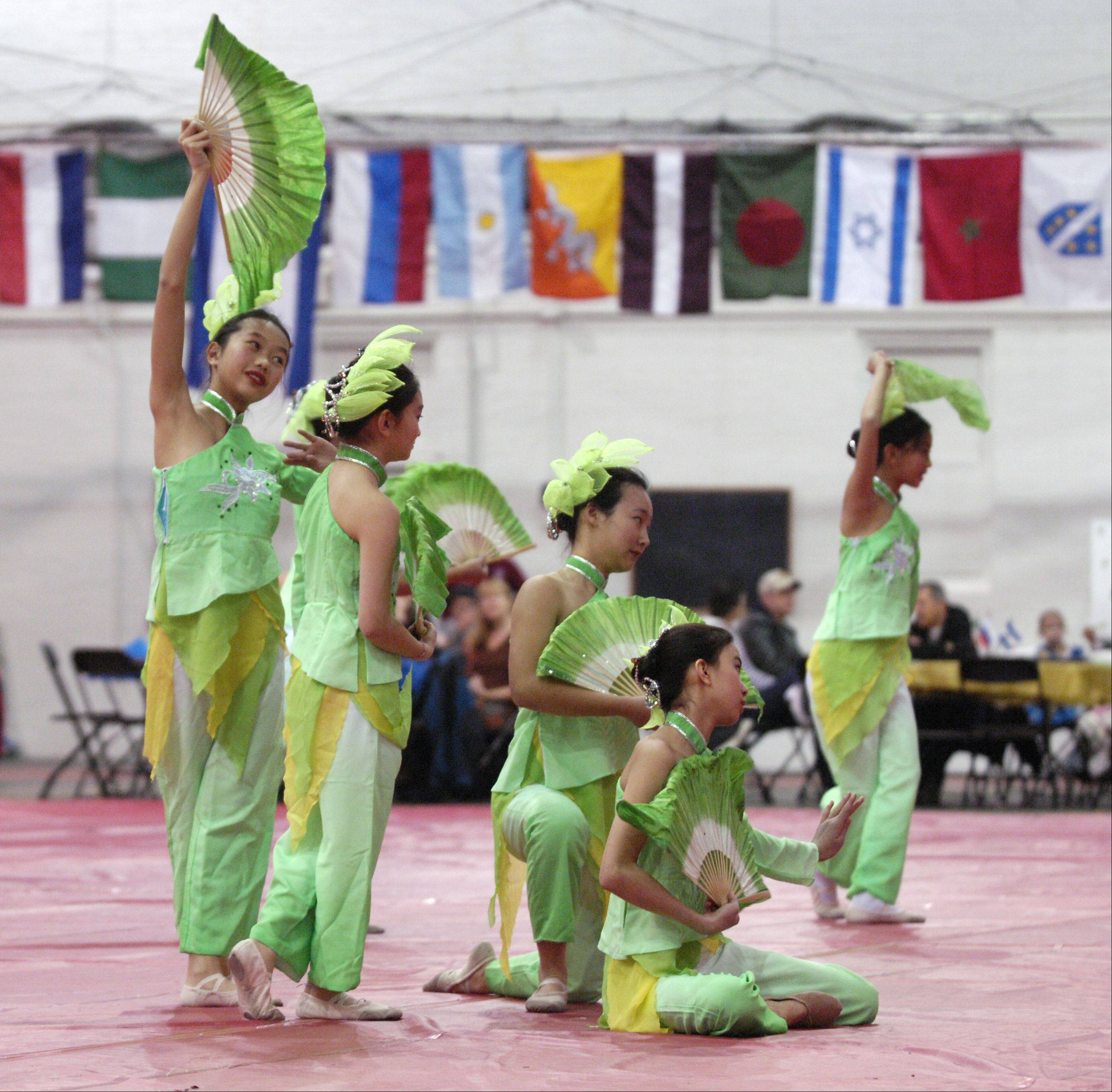 A dance group for the Xilin Asian Community Center in Naperville performs during North Central College's 17th annual International Festival in the Merner Field House in Naperville on Sunday.