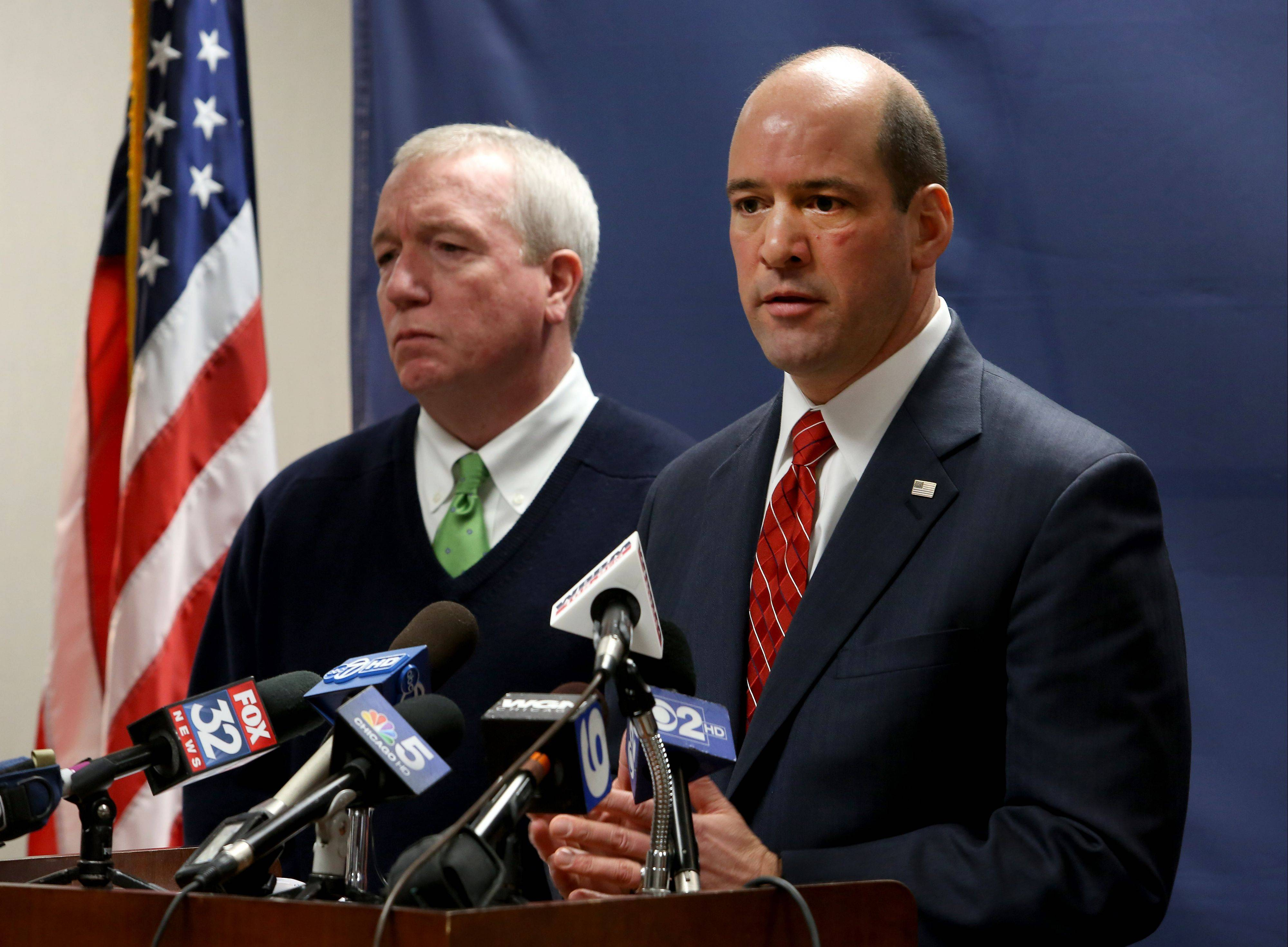 DuPage County State's Attorney Bob Berlin, along with U.S. Drug Enforcement Administration Special Agent Jack Riley, left, announce criminal charges against three Schaumburg police officers accused of dealing drugs.