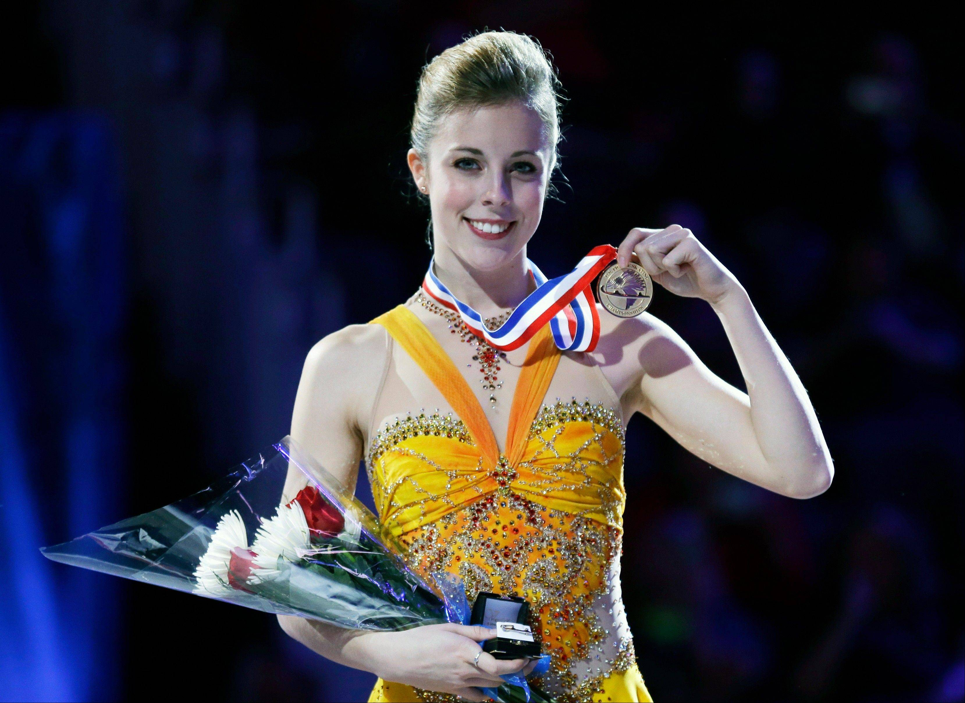 Ashley Wagner holds the gold medal after winning the senior ladies championship at the U.S. figure skating championships on Saturday.