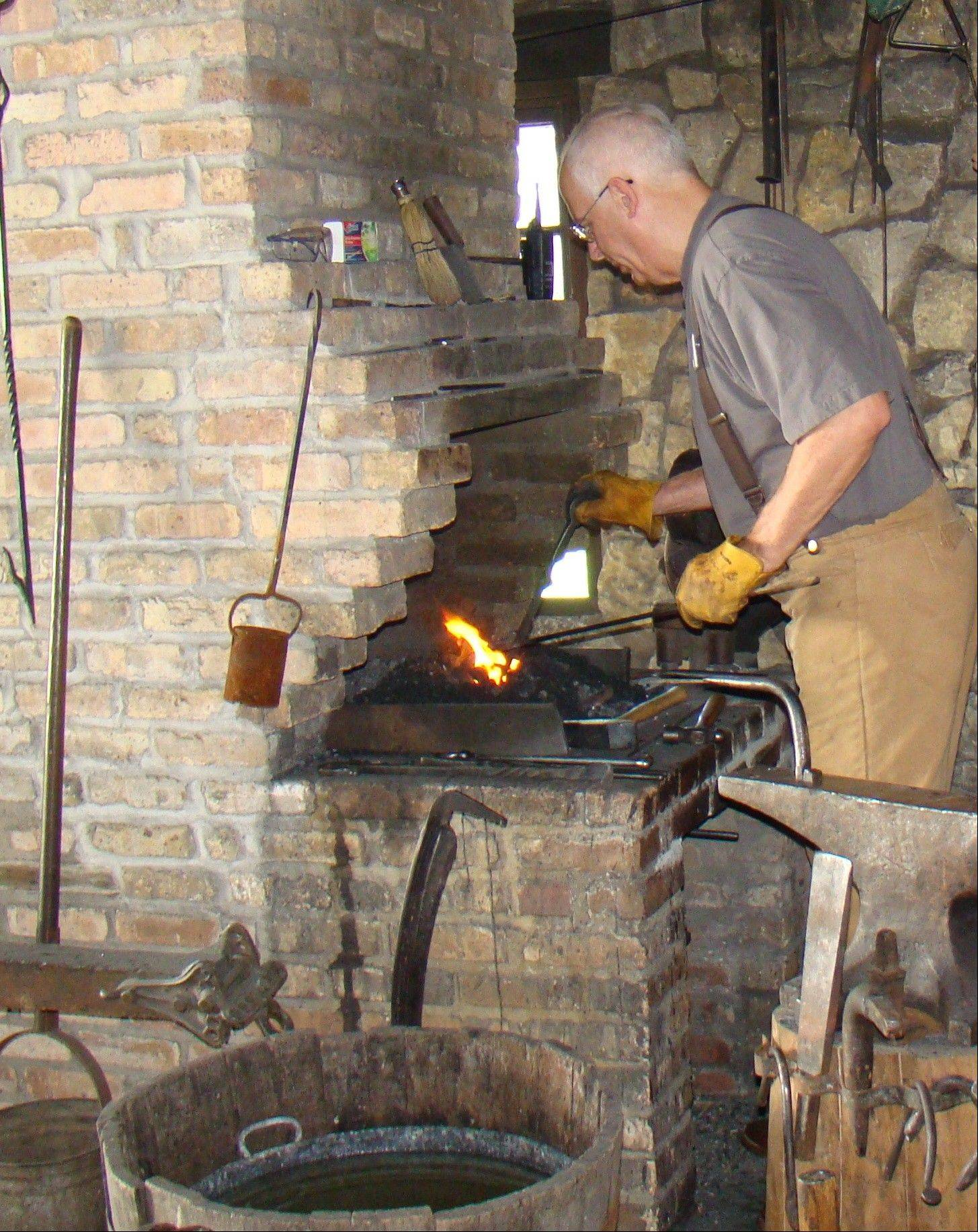 Greg Merriam works in the blacksmith shop, one of the many volunteer opportunities available at Naper Settlement.