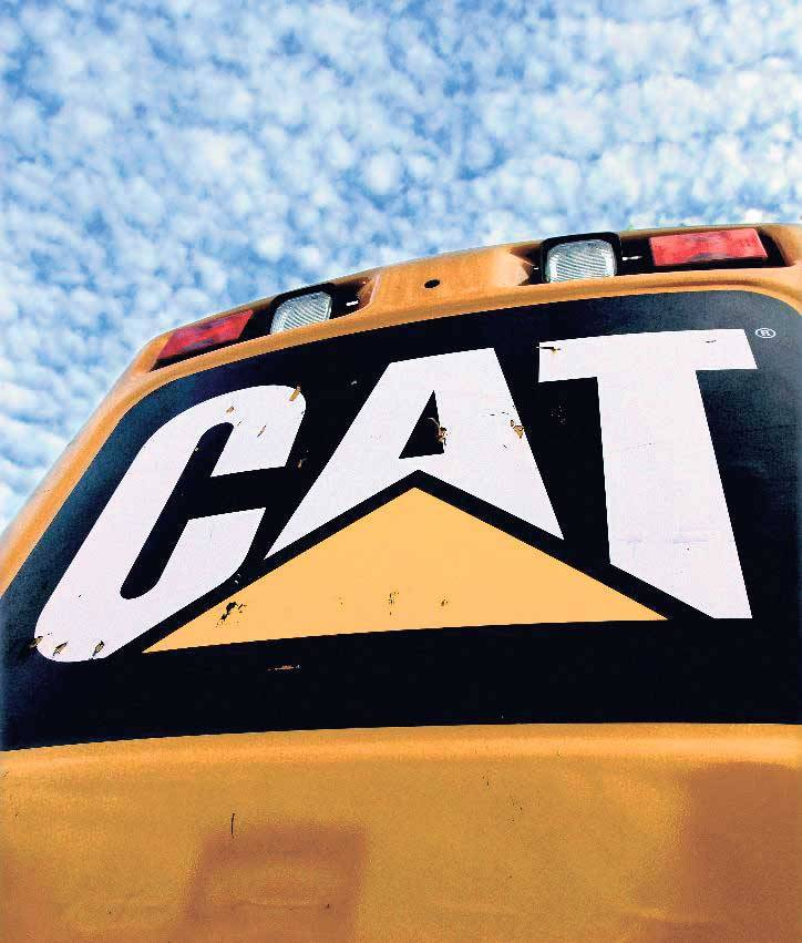 Caterpillar 4Q earnings fall by half