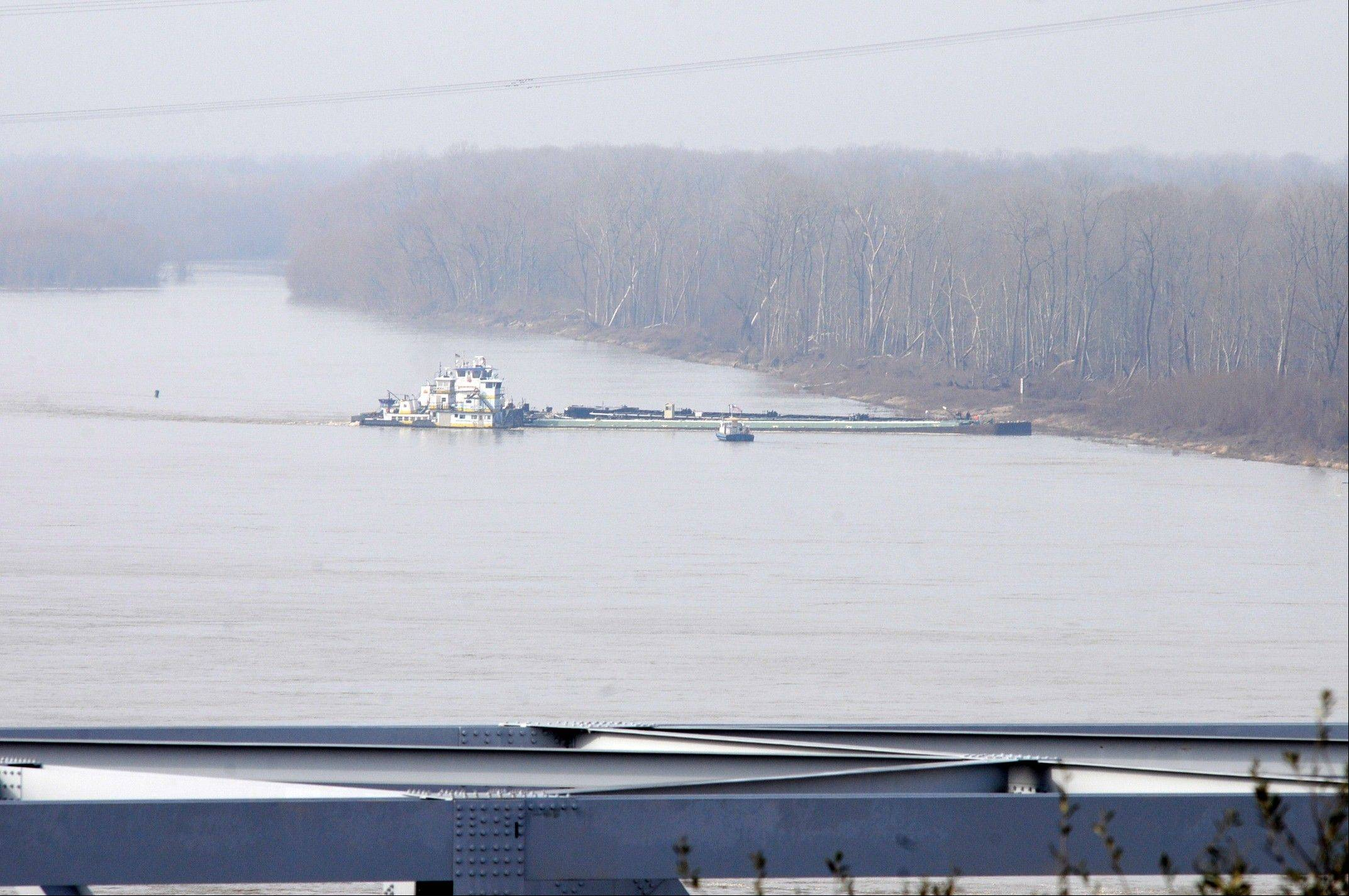 The towboat Nature Way Endeavor banks a barge against the western bank of the Mississippi River, Sunday.