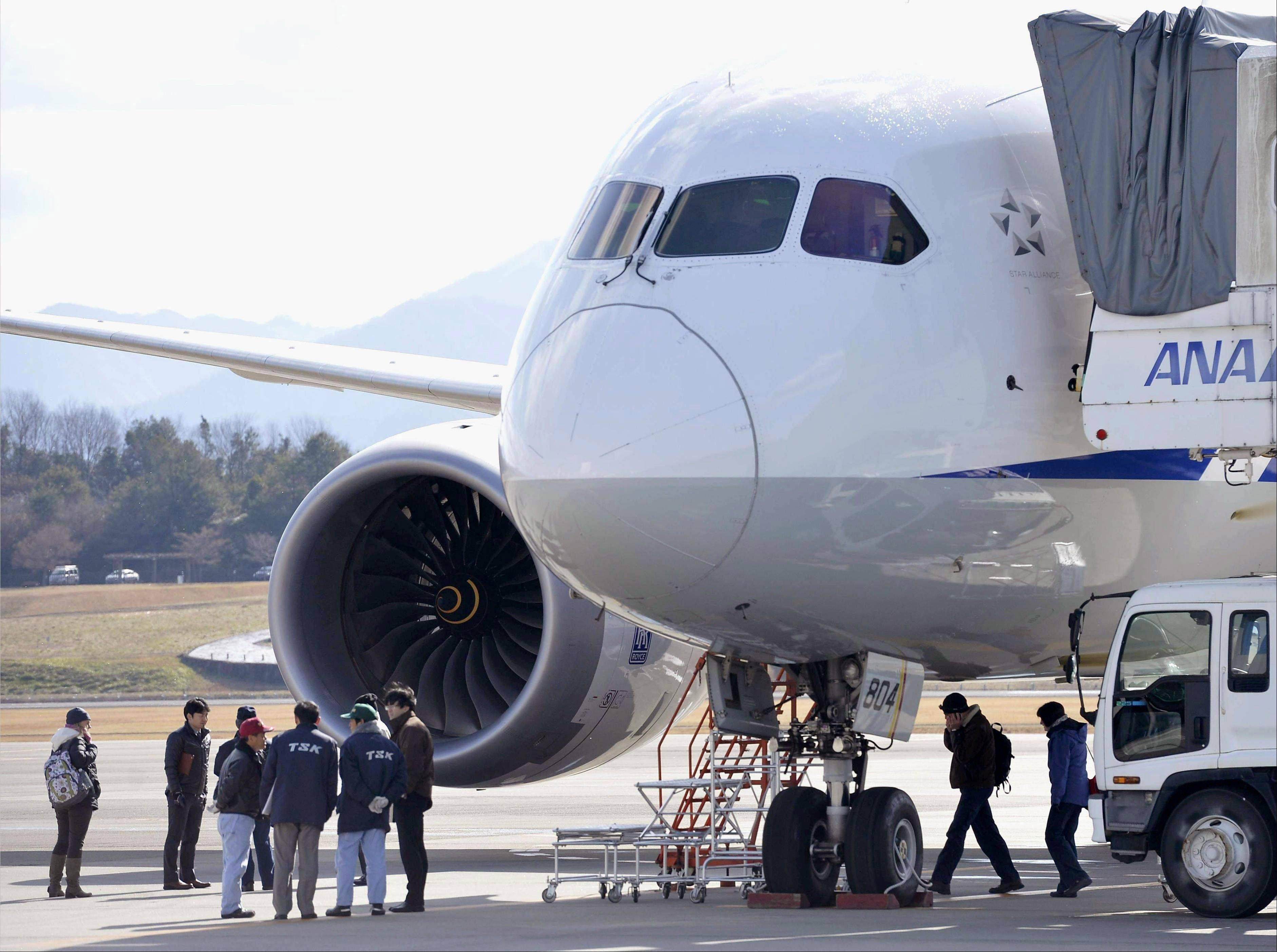 Officials inspect an All Nippon Airways Boeing 787 which made an emergency landing at Takamatsu airport in Takamatsu, western Japan.