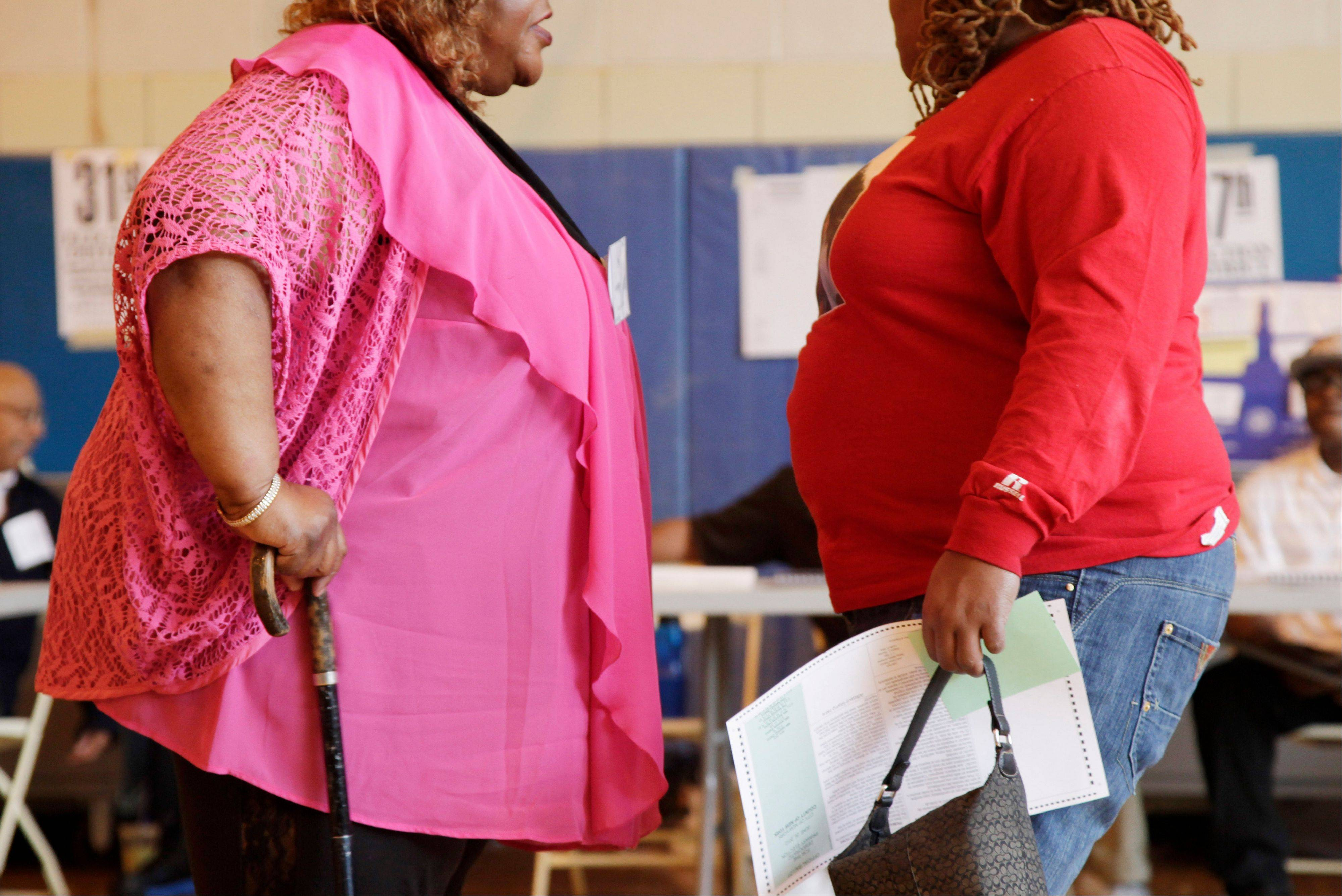 Two overweight women hold a conversation in New York. A new poll suggests that while more than 7 in 10 Americans can correctly tick off heart disease and diabetes as obesity's most serious consequences, few Americans are aware of the lesser-known health consequences — such as worsening some types of cancer, arthritis, sleep apnea and even infertility.
