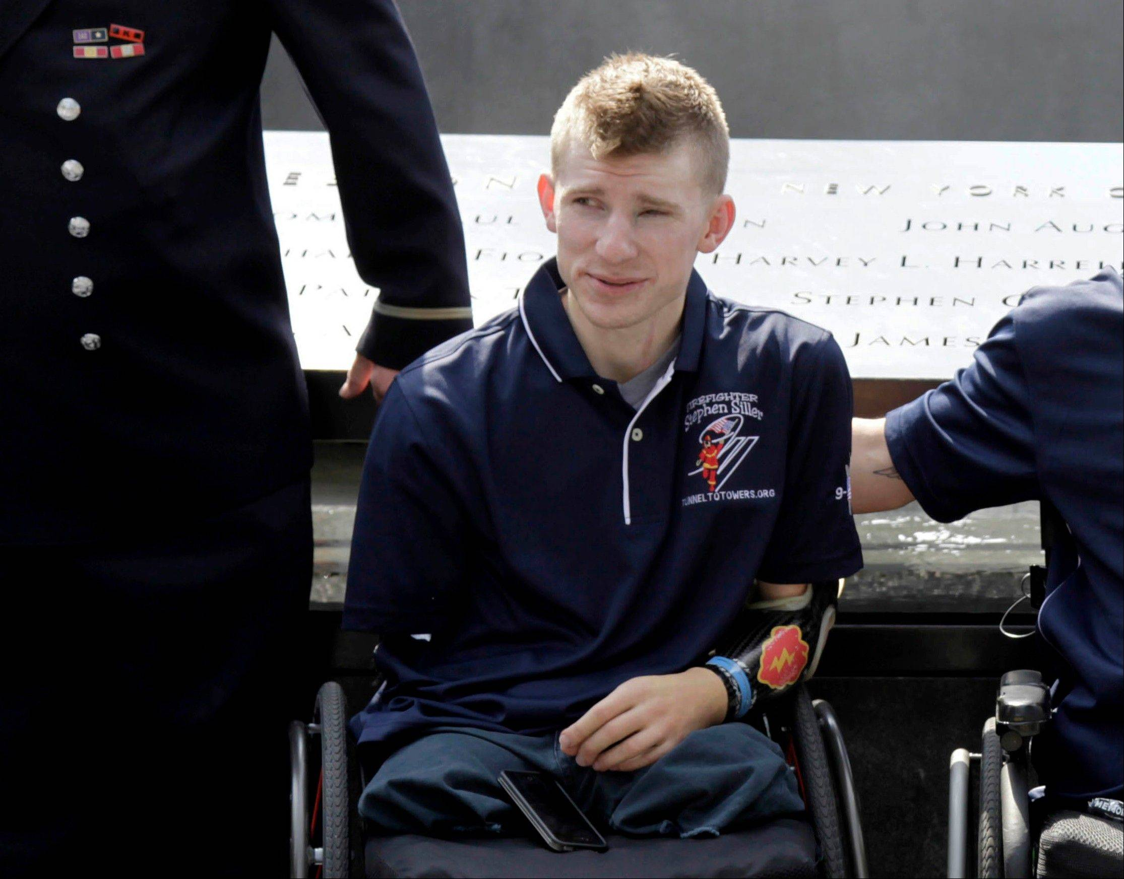 Army Sgt. Brendan Marrocco of Staten Island, N.Y., wearing a prosthetic arm, poses for a photo at the 9/11 Memorial in New York last July 4. Marrocco, 26, the first soldier to survive losing all four limbs in the Iraq war, has received a double-arm transplant in Baltimore.