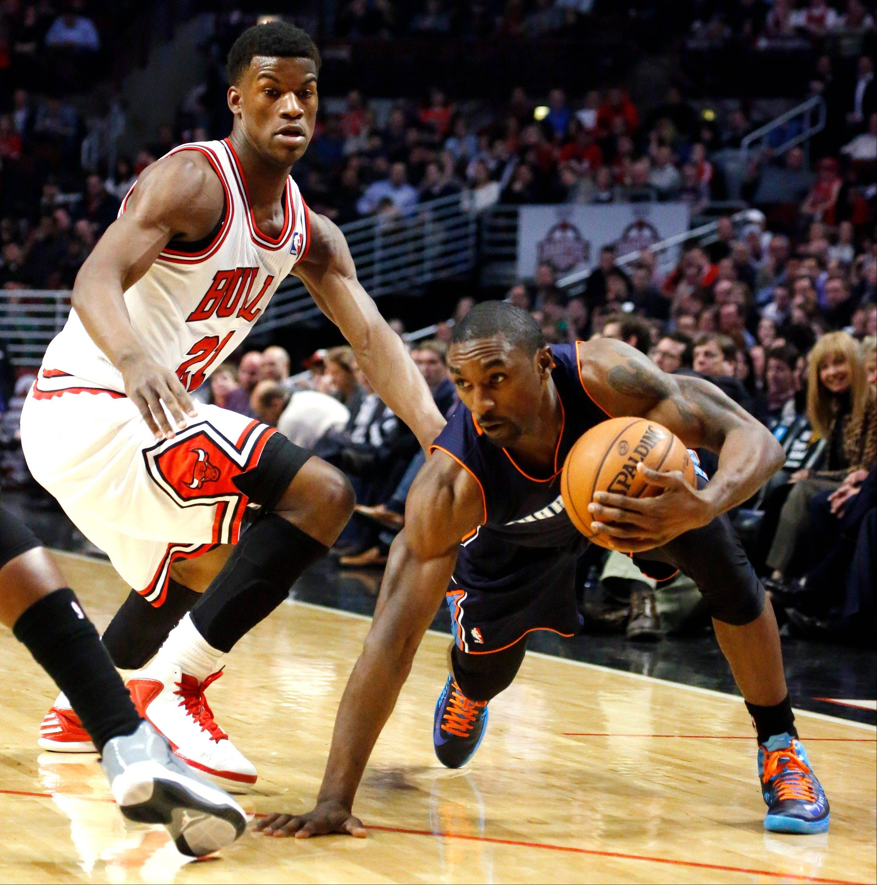 Charlotte Bobcats guard Ben Gordon, right, maintains his balance as Bulls forward Jimmy Butler defends during Monday's first half at United Center.