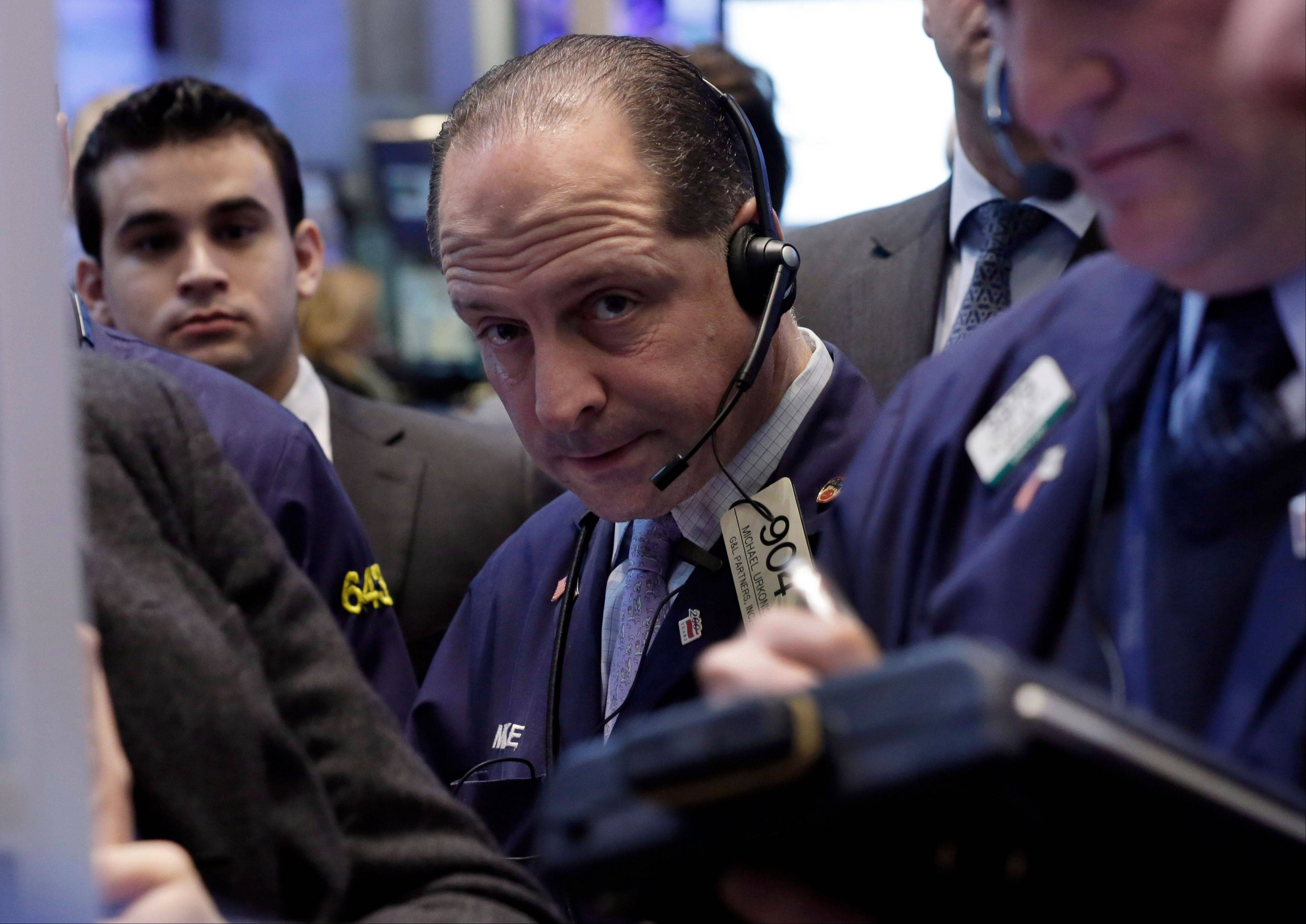 U.S. stocks fell Monday, following the longest rally for the Standard & Poor's 500 Index since 2004, as a drop in pending home sales overshadowed a rise in durable-goods orders while investors watched earnings.