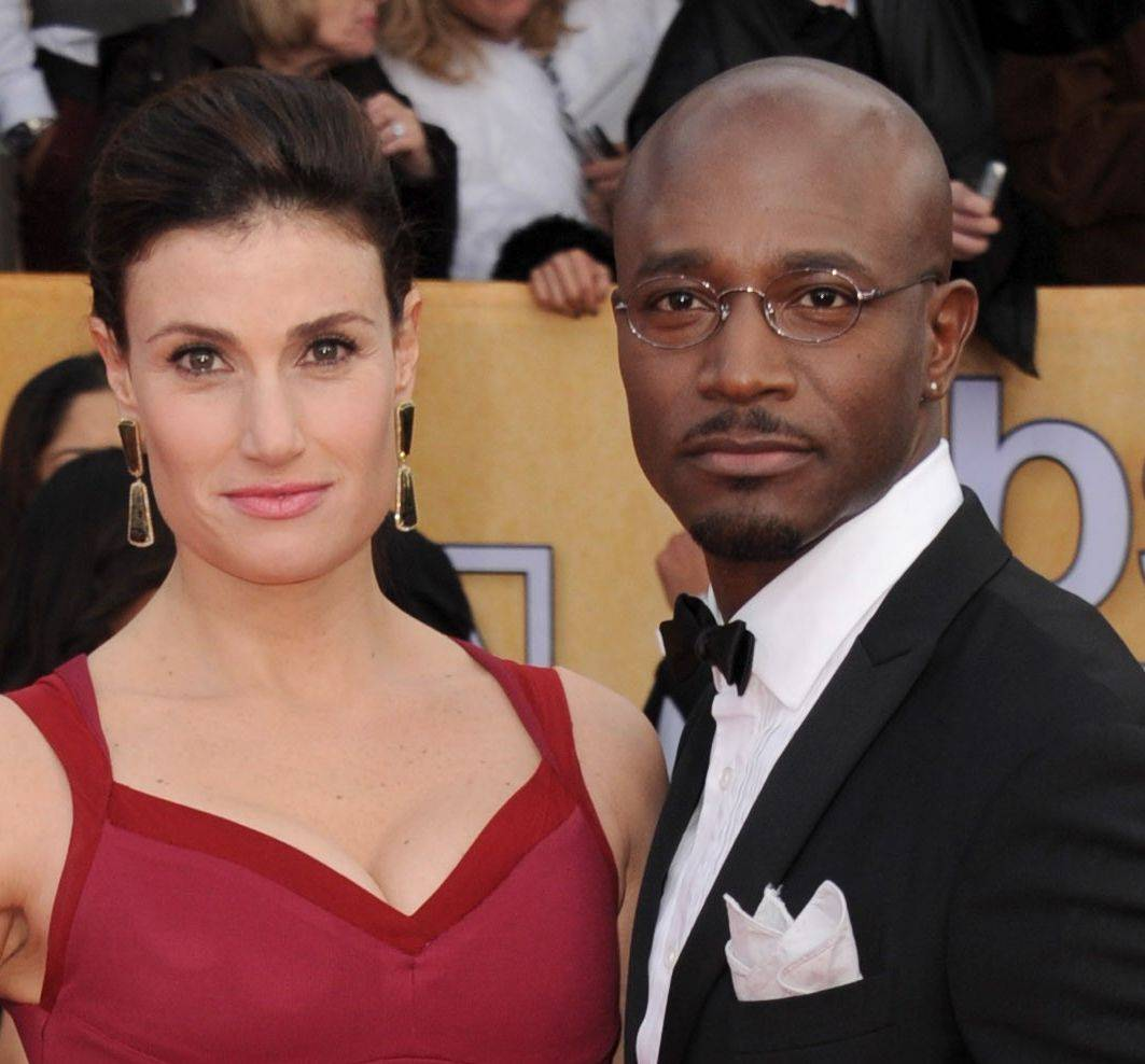 Actors Idina Menzel, left, and Taye Diggs arrive at the 19th Annual Screen Actors Guild Awards at the Shrine Auditorium in Los Angeles on Sunday. When the couple arrived home from the awards they found an intruder in the garage. Diggs chased the suspect down and held him until police arrived.