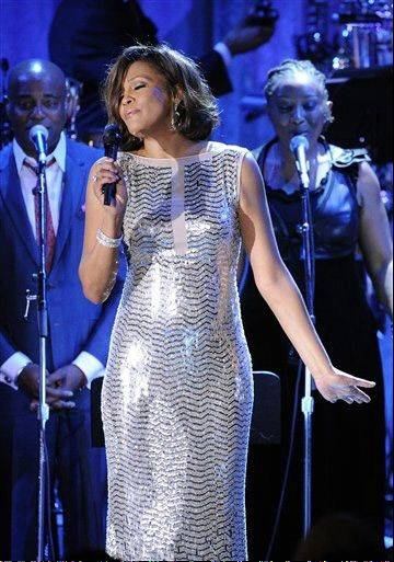 "In this Feb. 13, 2011 file photo, singer Whitney Houston performs at the pre-Grammy gala & salute to industry icons with Clive Davis honoring David Geffen in Beverly Hills, Calif. Houston's mother, Cissy, writes in a book released today of her daughter whom she called ""Nippy,"" ""In my darkest moments, I wonder whether Nippy loved me."""