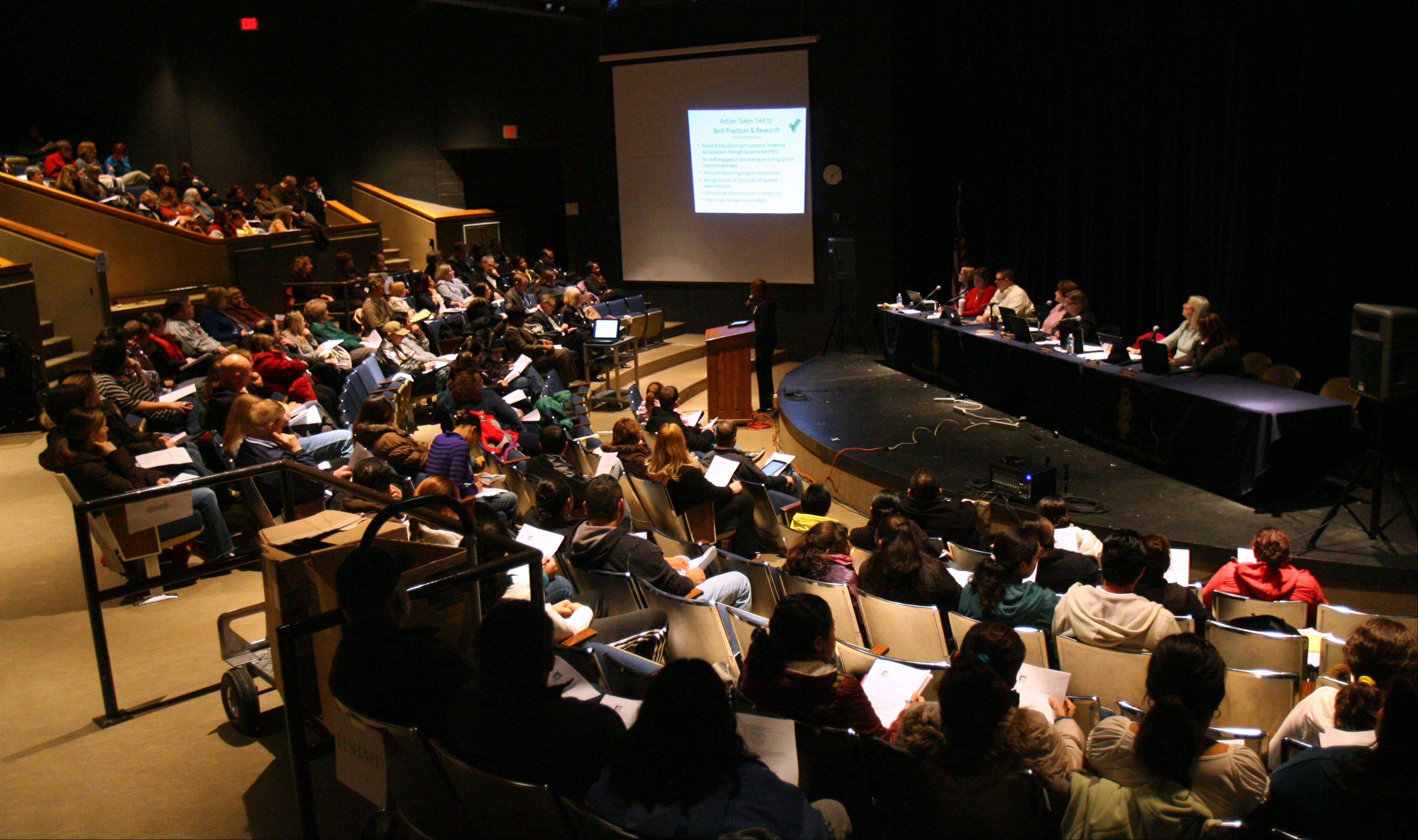 Parents filled the Round Lake High School theater Monday night to hear the Round Lake Area Unit District 116 board lay out their plan to restructure seven elementary schools in an effort to improve student academic achievement.