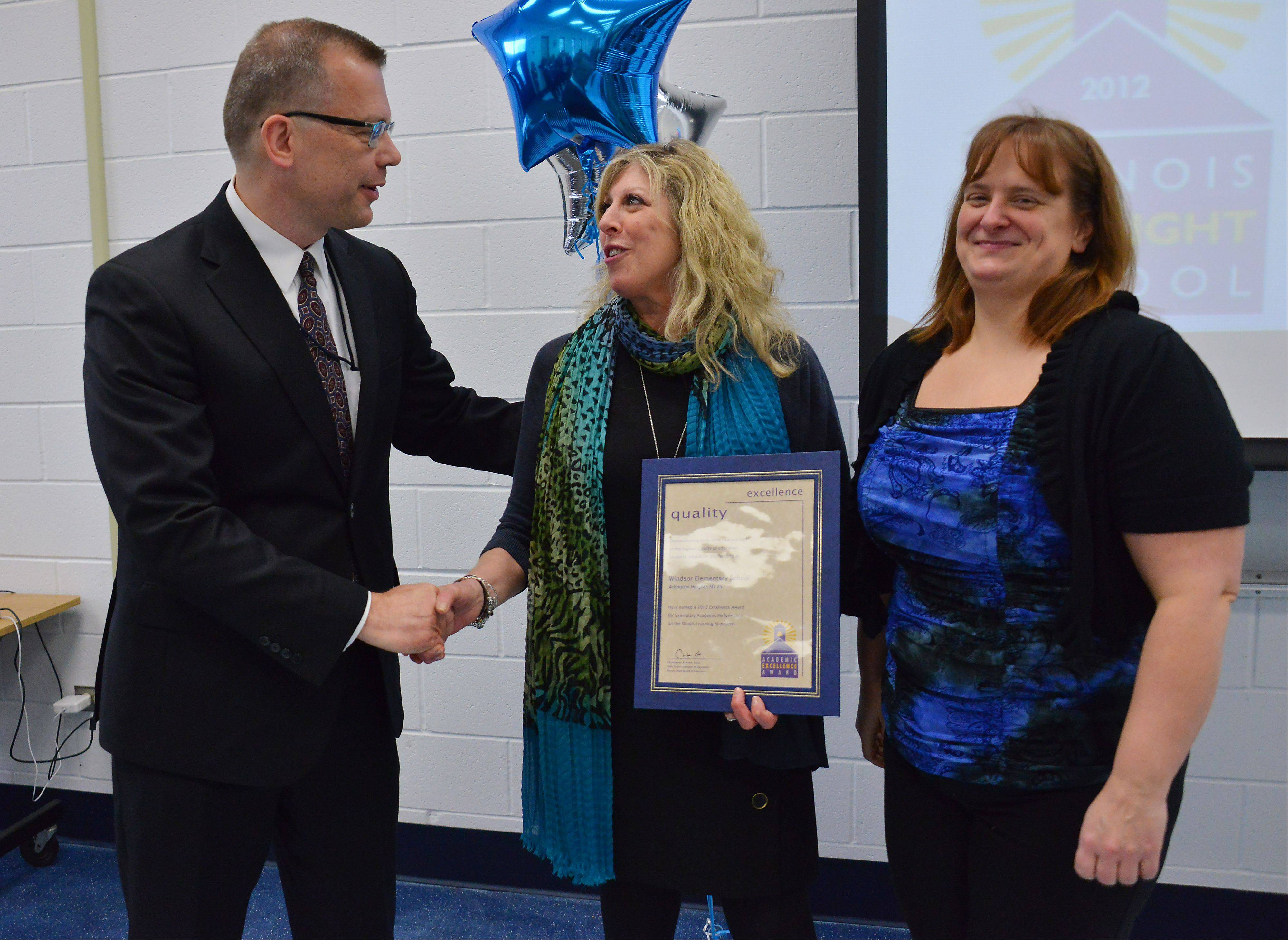 Shelly Fabrizio and Amy Pinski of Arlington Heights District 25's Windsor Elementary School received the Academic Excellence Award from State Superintendent Christopher Koch. Several awards were presented Monday at John Jay Elementary School in Mount Prospect.