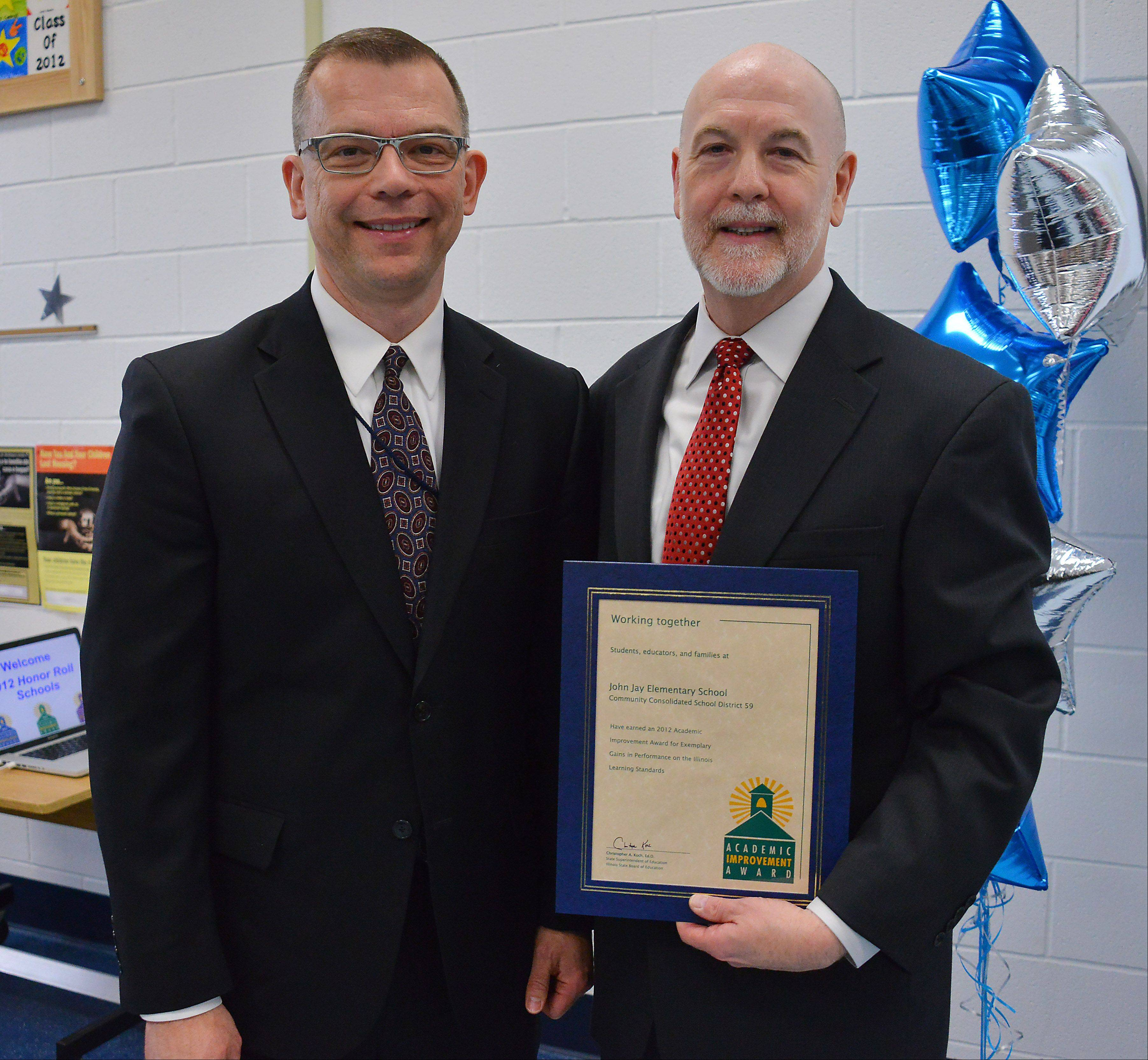 John Jay Elementary School Principal Dr. Thomas Seaton, right, with State Superintendent of Education Christopher Koch after receiving the Academic Improvement Award. The Mount Prospect School hosted an awards ceremony Monday for several Northwest suburban schools receiving the honor.