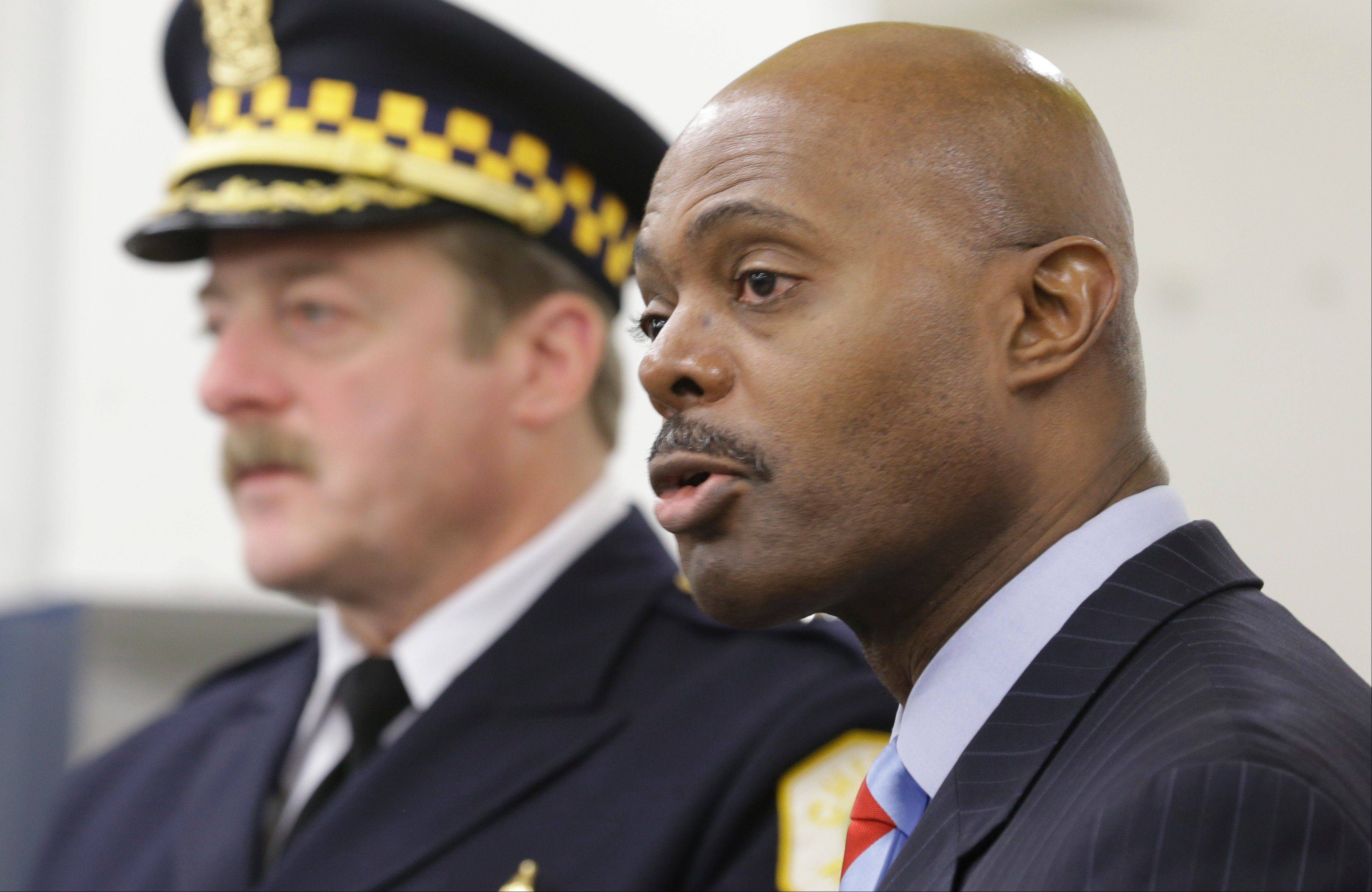 "Chicago Police First Deputy Superintendent Alfonsa Wysinger, right, accompanied by Deputy Chief Wayne Gulliford speaks at a news conference Monday in Chicago. Wysinger called the spate of shootings ""frustrating"" for the department."