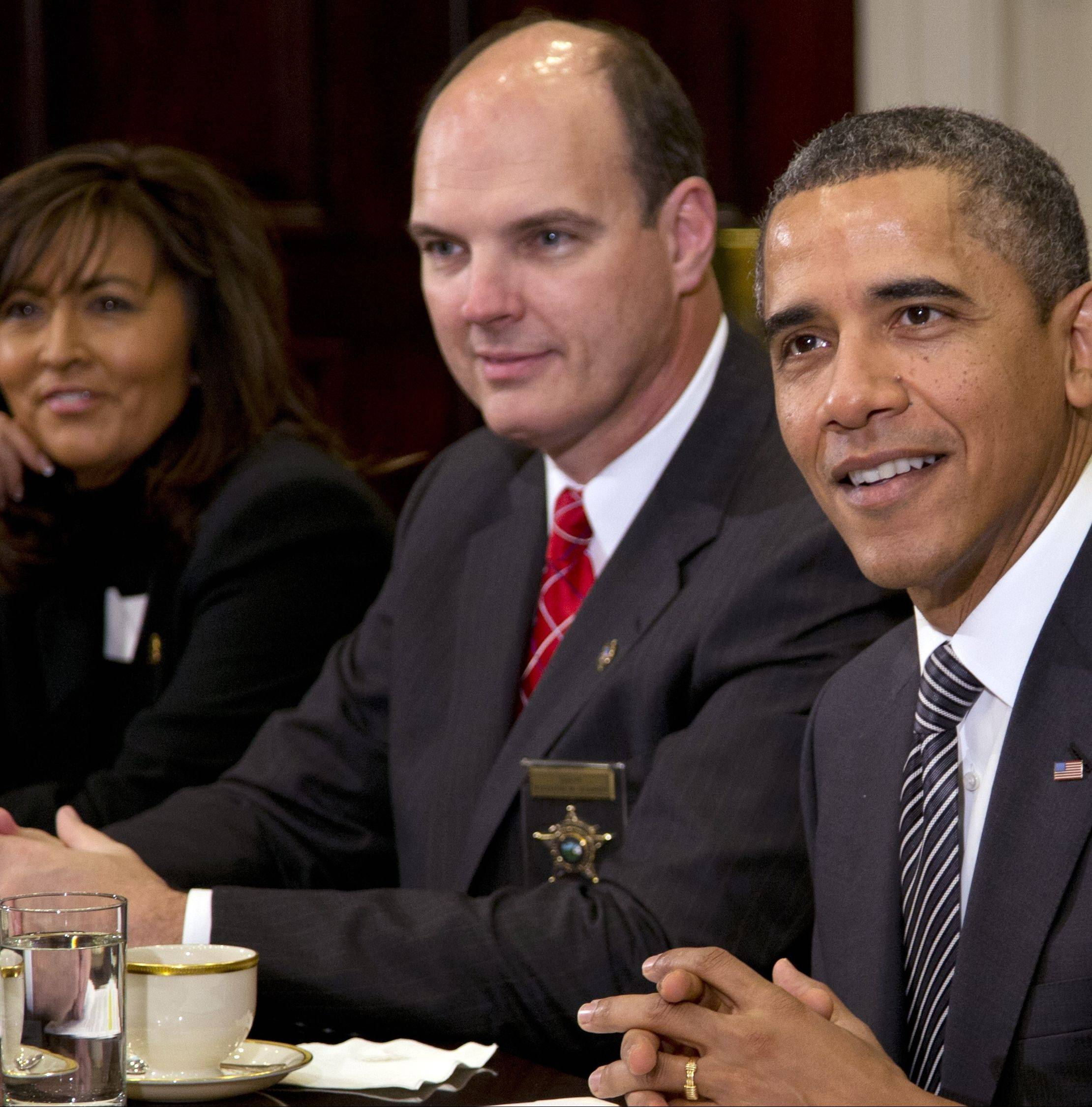 President Barack Obama meets with police chiefs and county sheriffs Monday to discuss gun violence. From left are Minneapolis Police Chief Janee Harteau and Hennepin County (Minn.) Sheriff Richard W. Stanek.