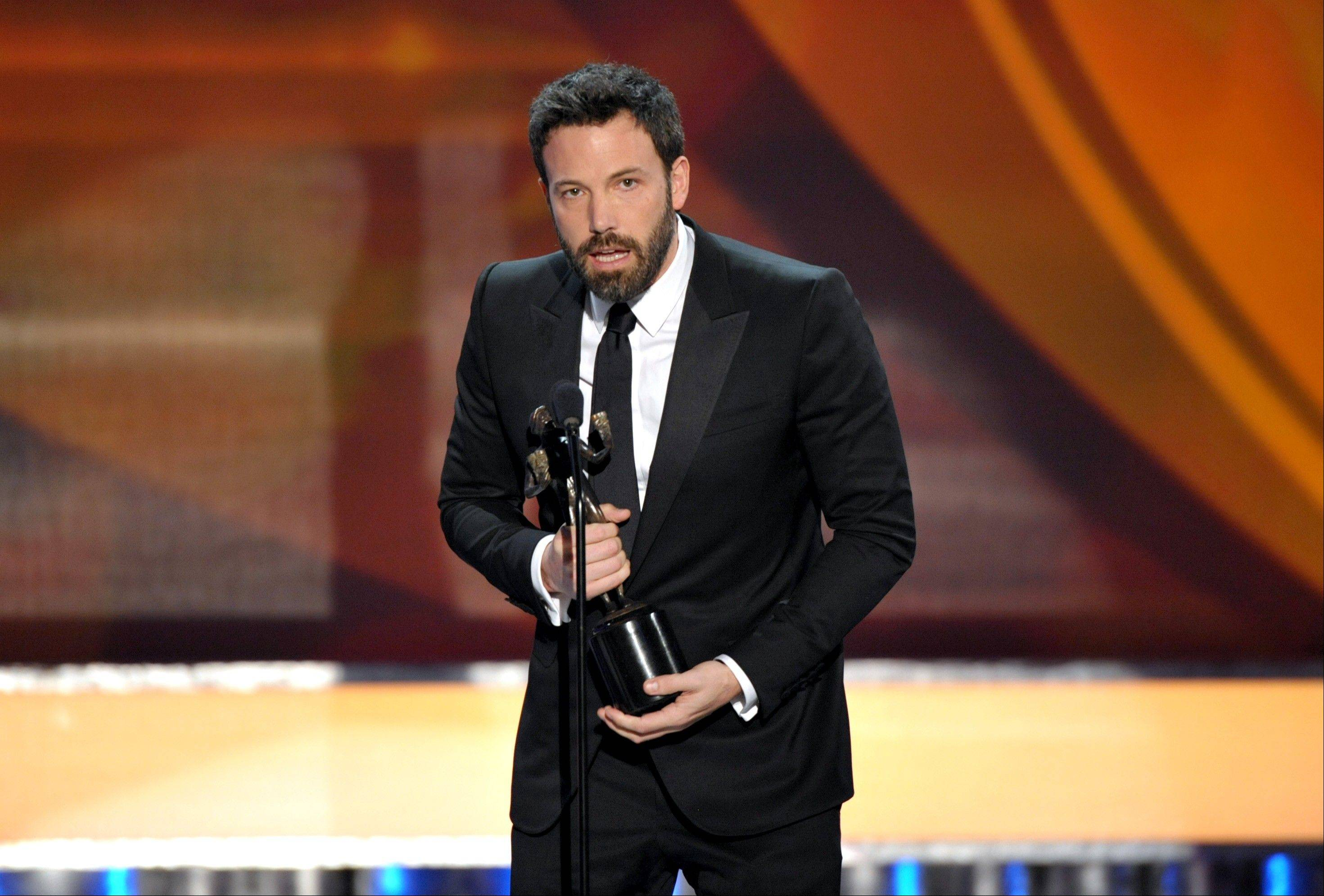 "Ben Affleck accepts the award for outstanding cast in a motion picture for ""Argo"" at the 19th Annual Screen Actors Guild Awards at the Shrine Auditorium in Los Angeles on Sunday."
