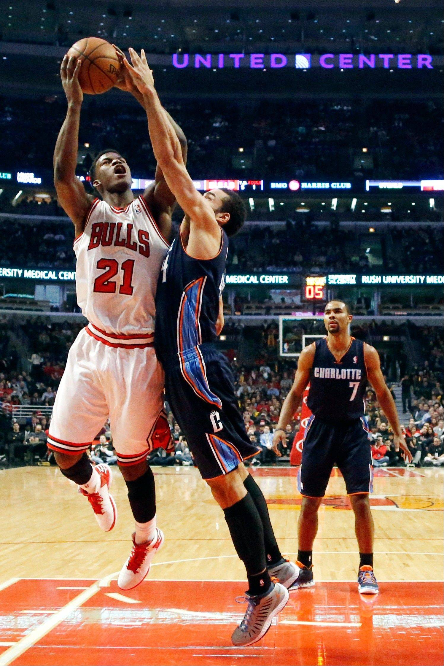 The Bulls' Jimmy Butler shoots over Charlotte's Jeffery Taylor on his way to a career-high 19 points Monday night.