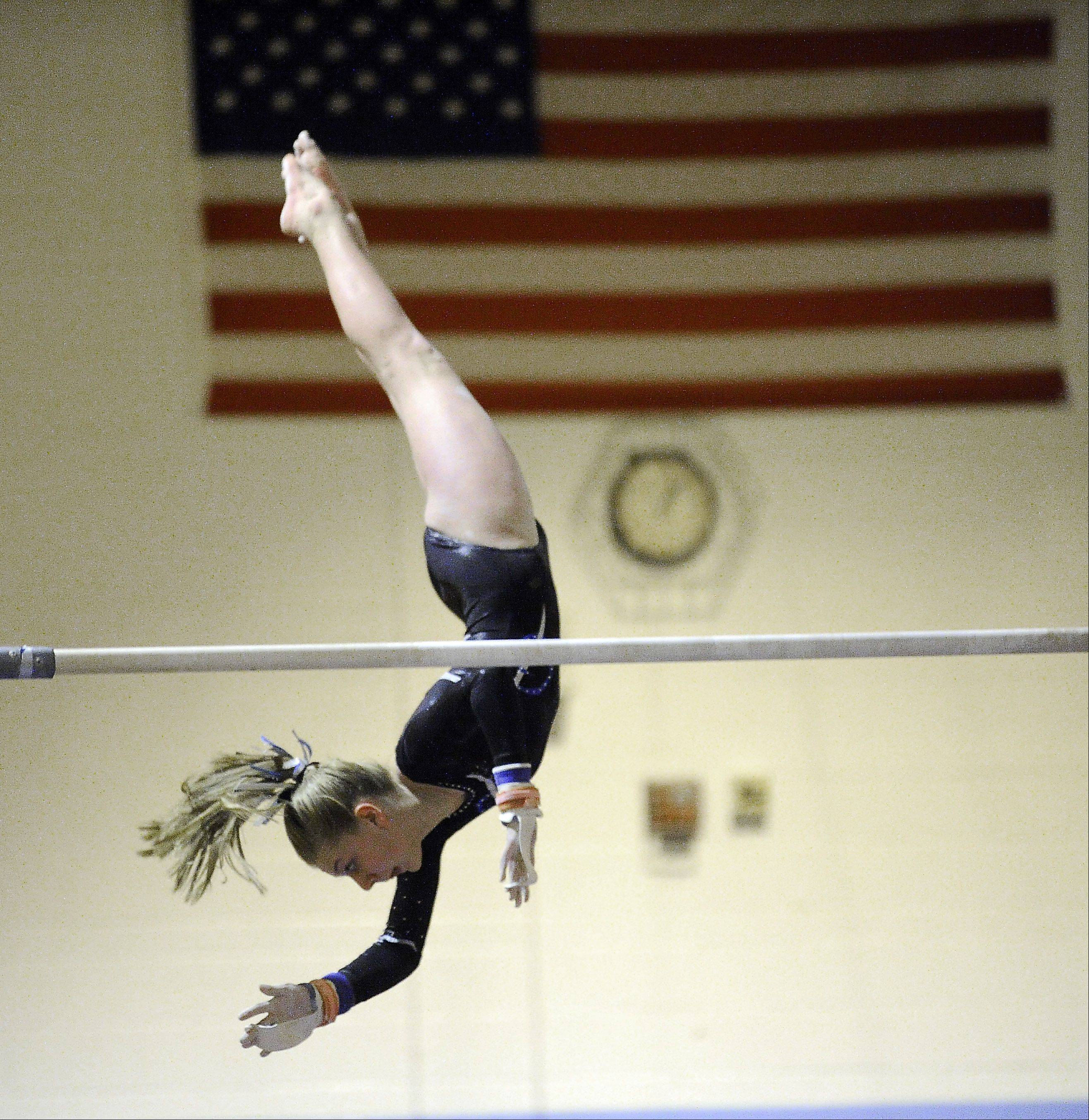 Maddie Boldt of Prospect performs her routine on the uneven parallel bars at the Prospect regional on Monday.
