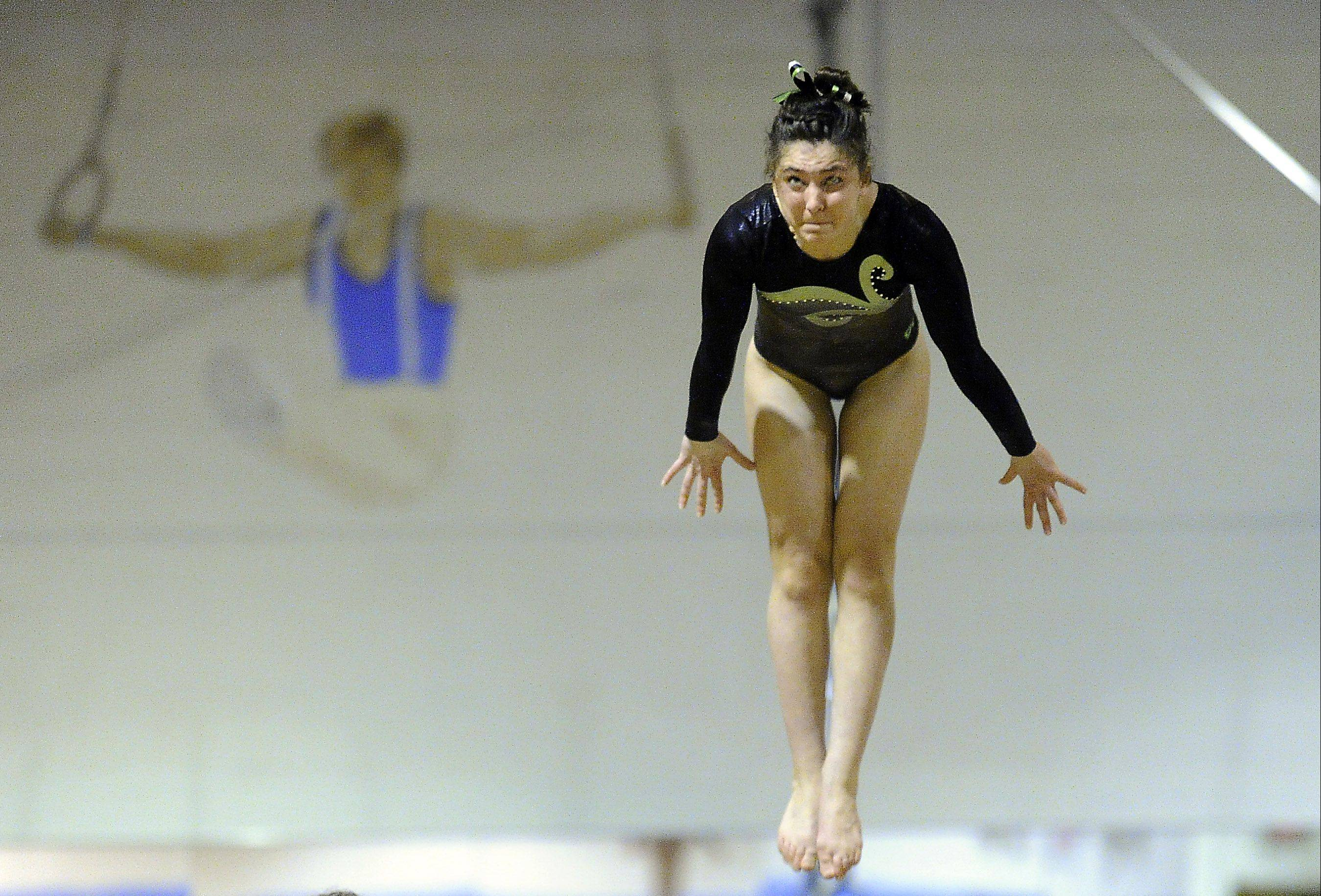 Amelia Rafferty of Elk Grove performs her vault routine at the Prospect regional on Monday.