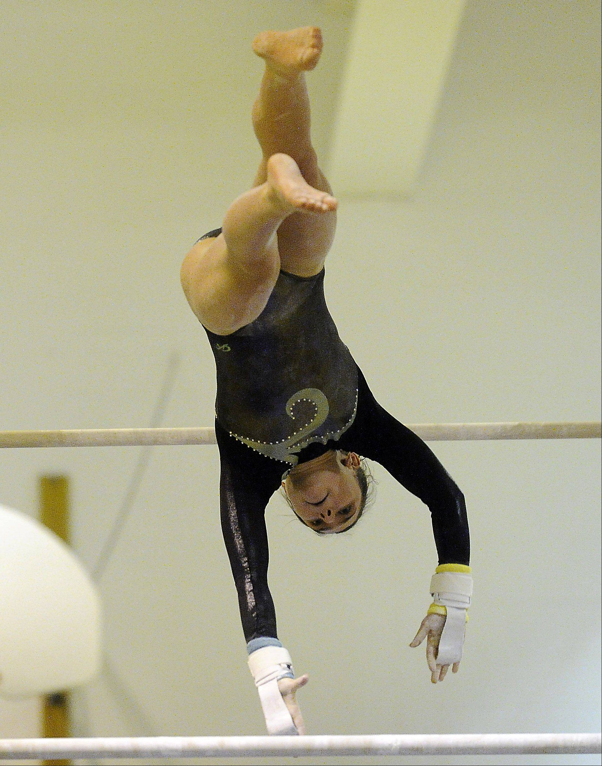 Amelia Rafferty of Elk Grove performs her routine on the uneven parallel bars at the Prospect regional on Monday.