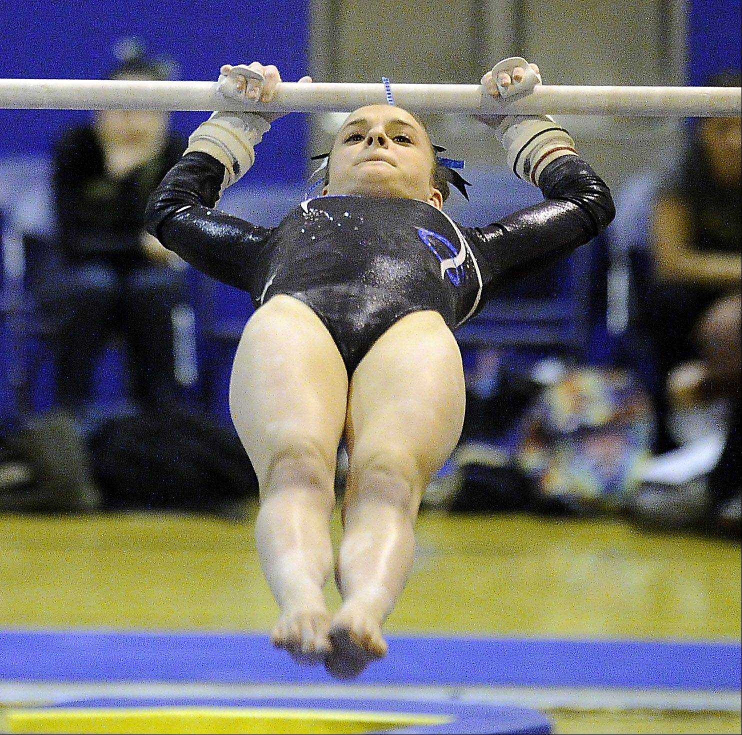 Maddie Larock of Prospect performs her routine on the uneven parallel bars at the Prospect regional on Monday.