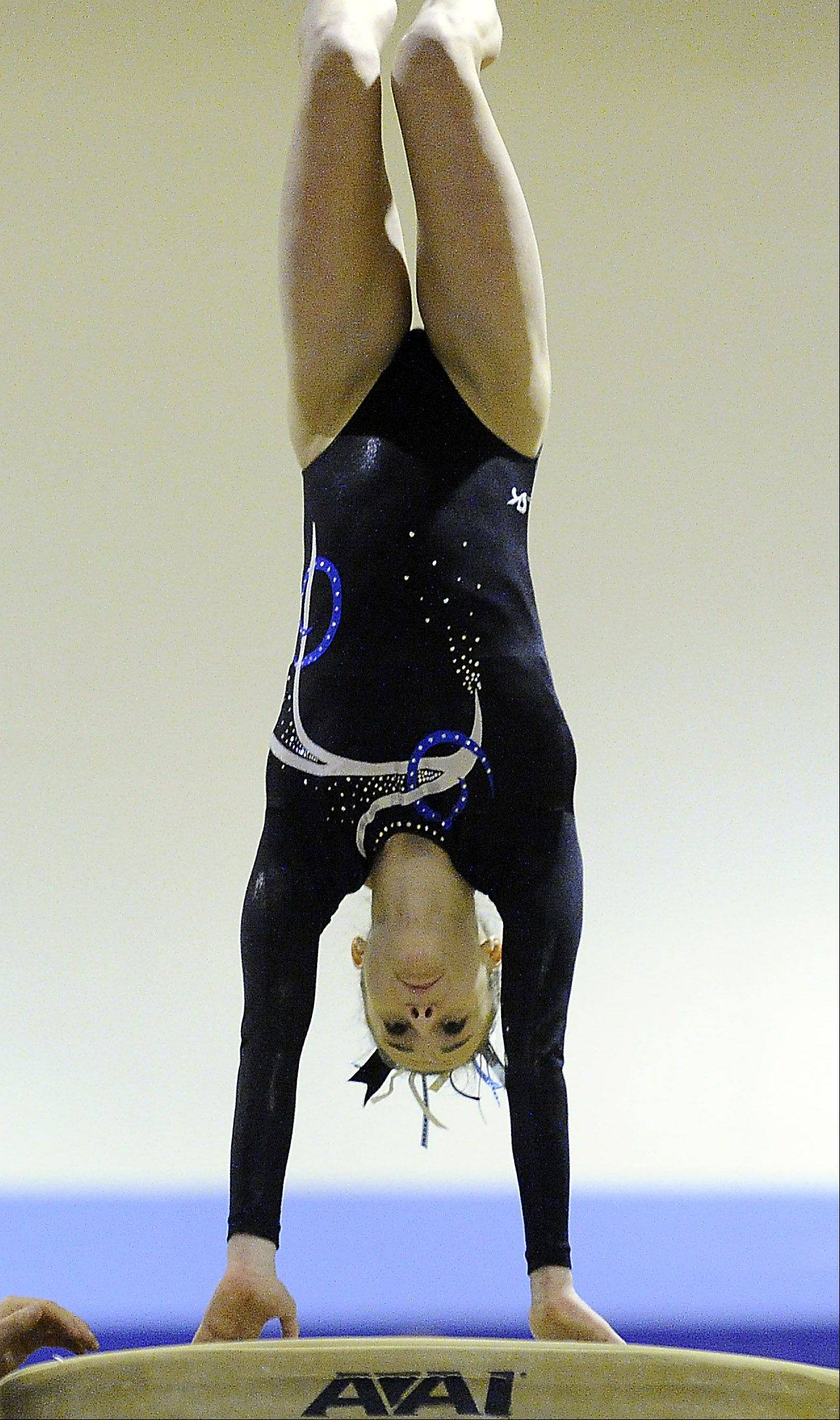 Maddie Larock of Prospect performs her vault routine at the Prospect regional on Monday.