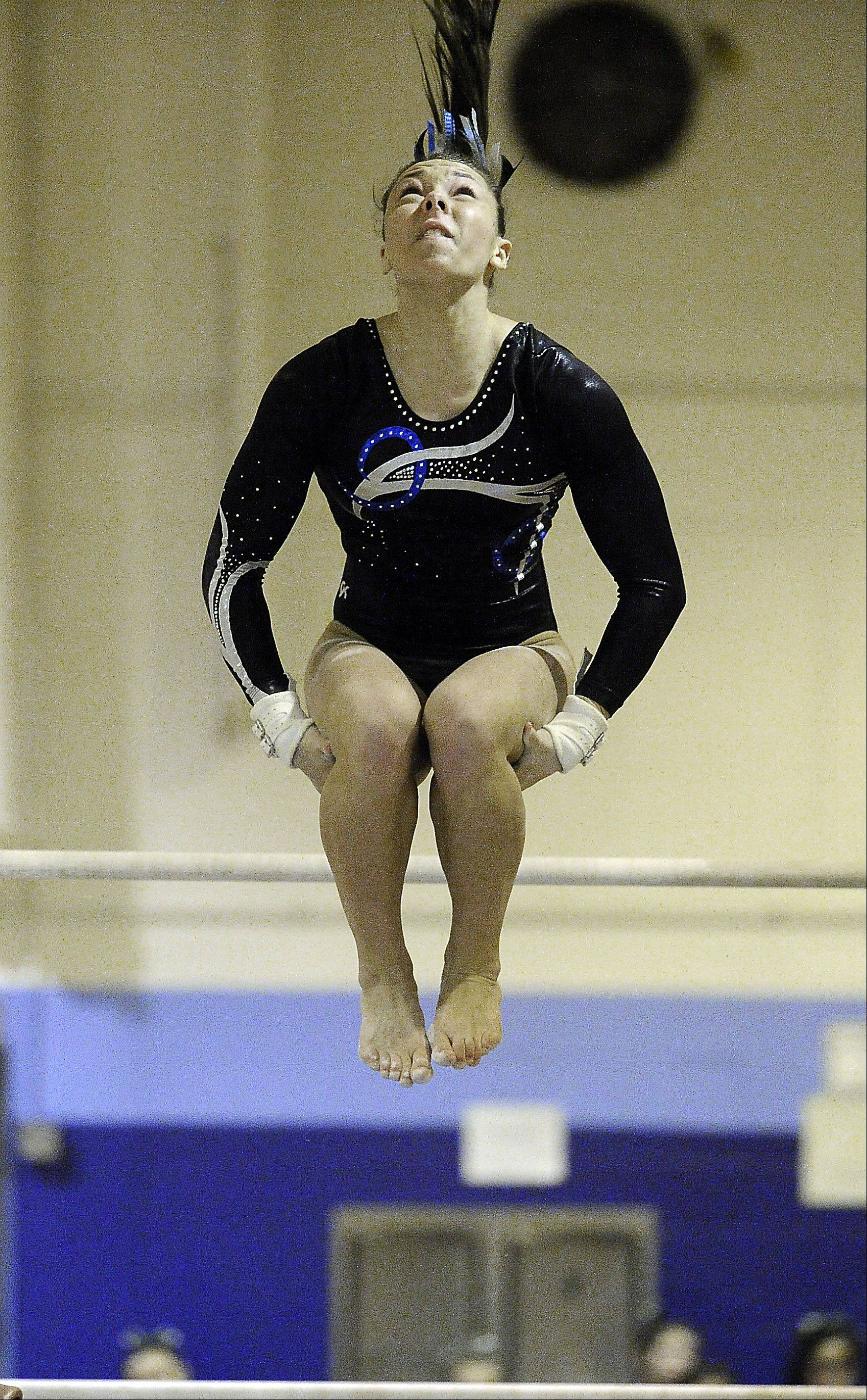 Gianna Scala of Prospect performs her routine on the uneven parallel bars at the Prospect regional on Monday.