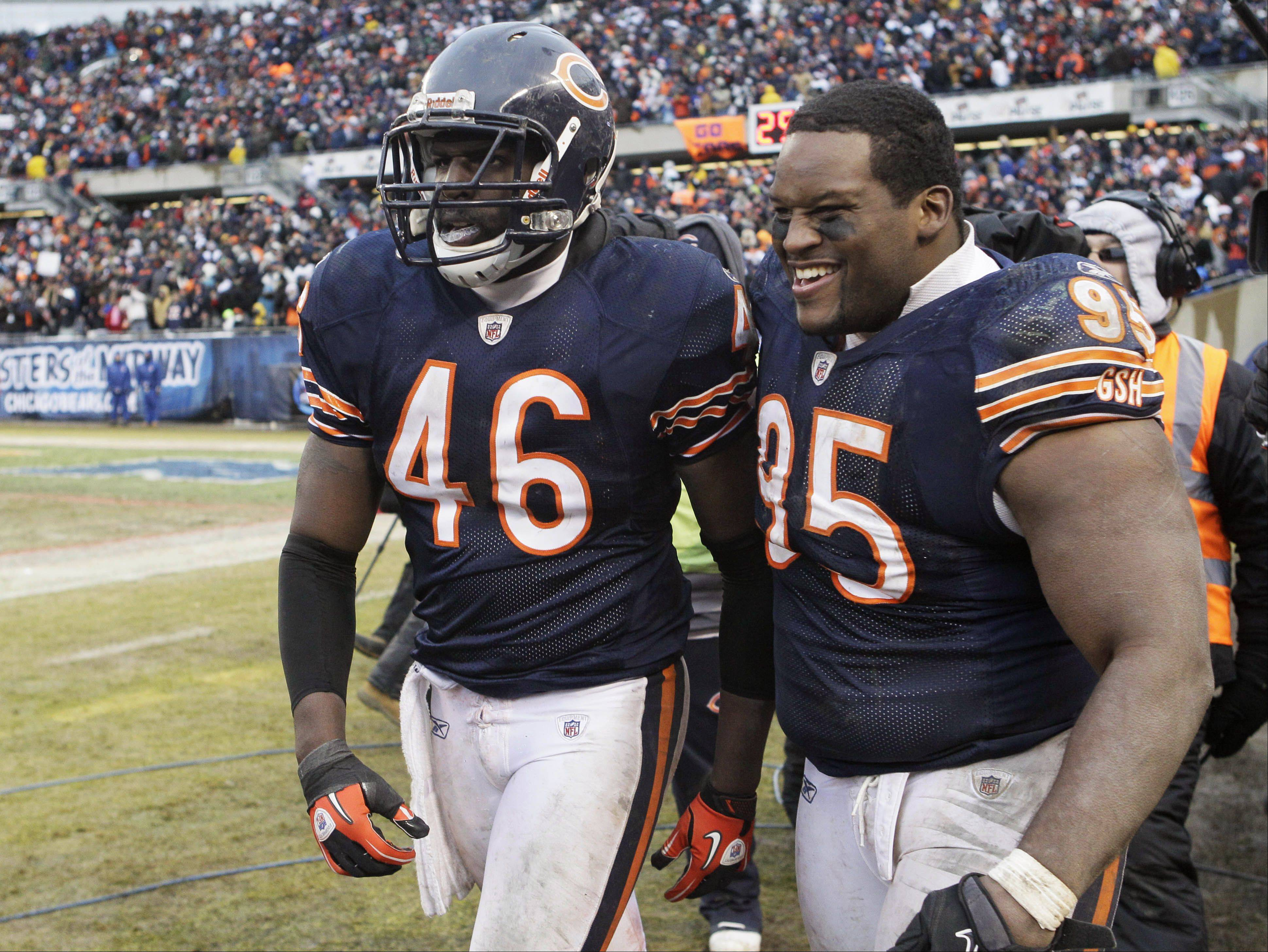 Chicago Bears safety Chris Harris (46) celebrates with Anthony Adams (95) after Harris' interception late in the NFL football game against the New York Jets on Sunday, Dec. 26, 2010, in Chicago. The Bears won 38-34.