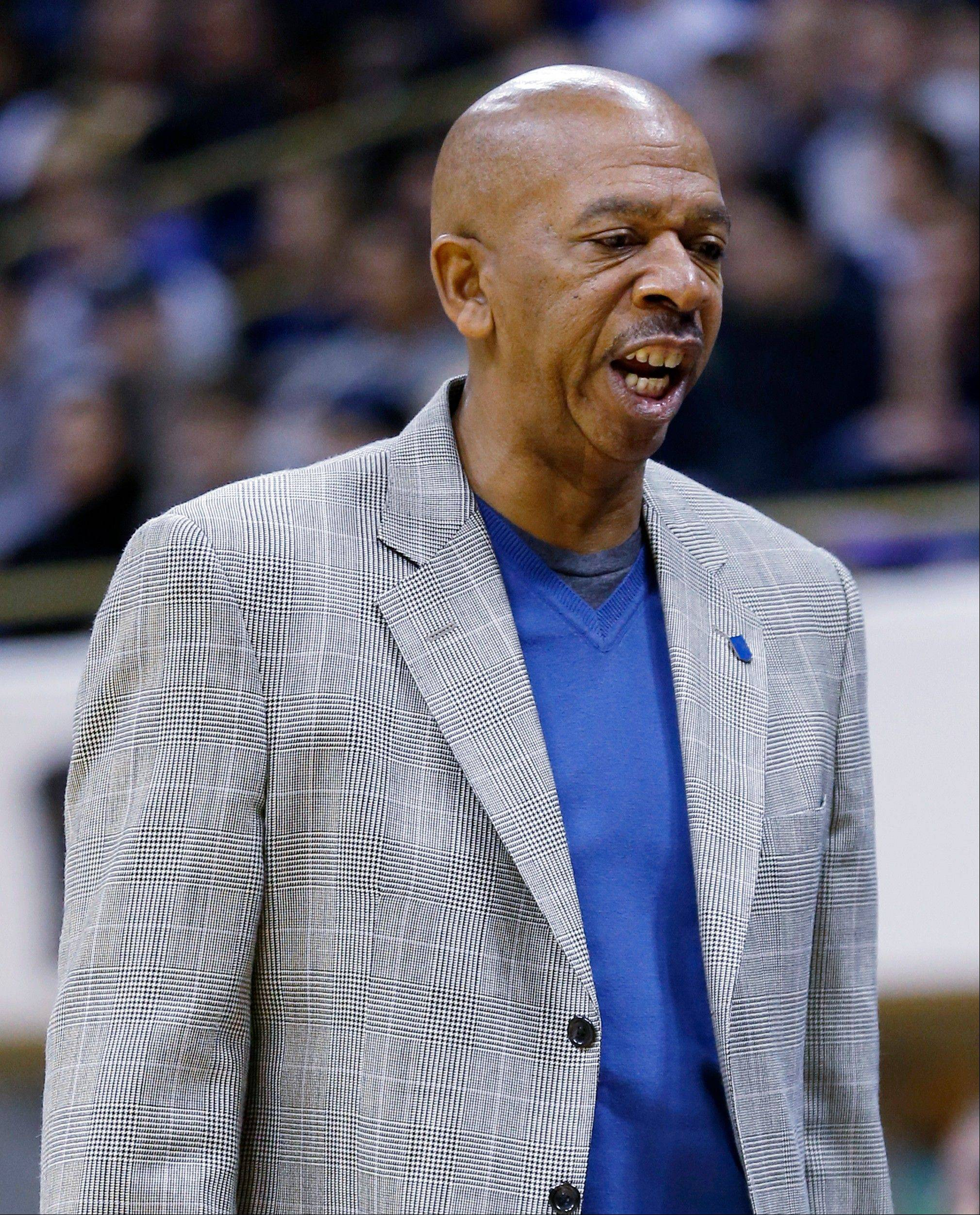 DePaul head coach Oliver Purnell talks to his team in the first half of the NCAA college basketball game against Pittsburgh on Saturday, Jan. 26, 2013 in Pittsburgh. Pittsburgh won 93-55.