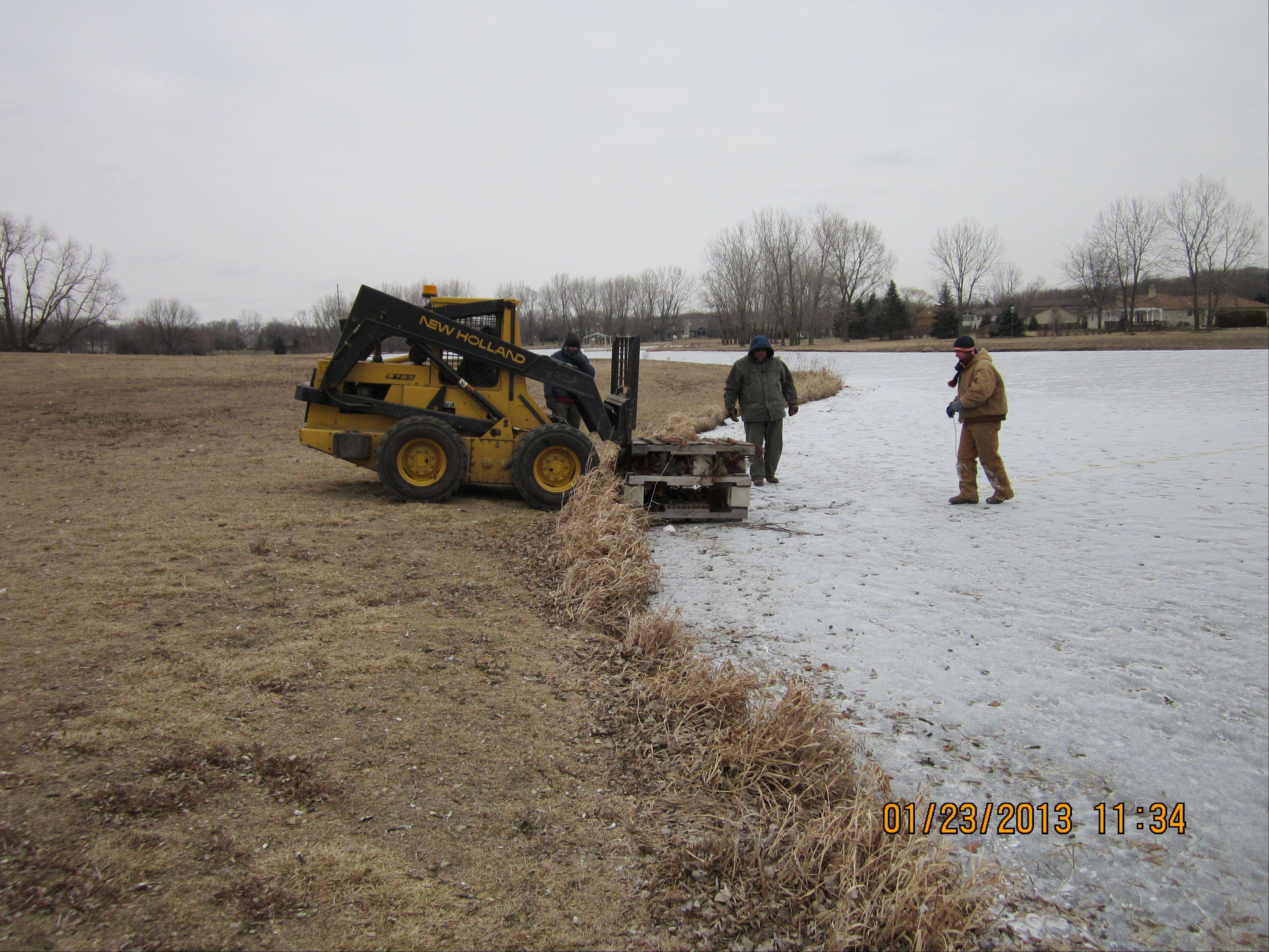 Bartlett Parks Department staff place fish cribs on the ice at Beaver Pond.