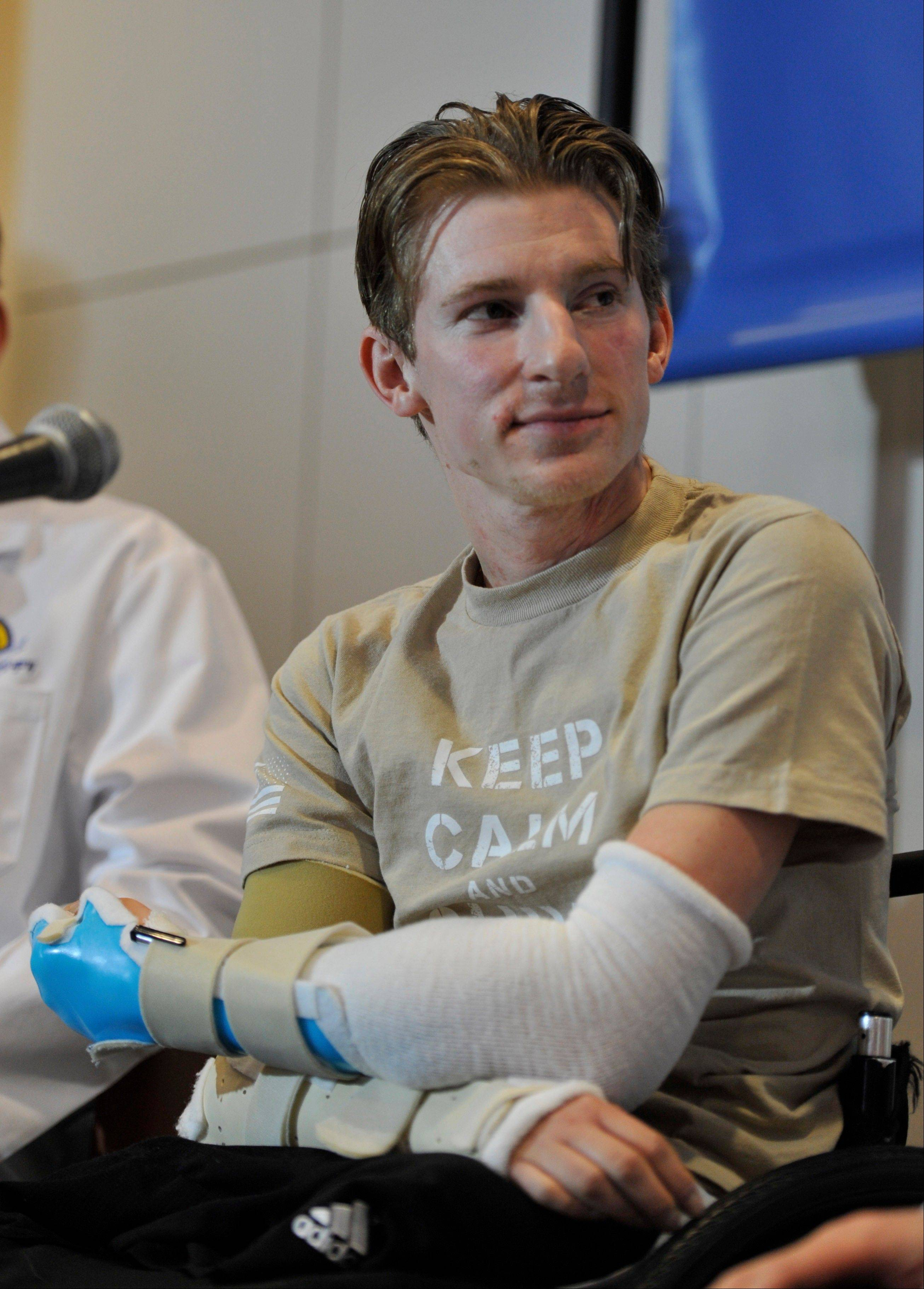 Retired Infantryman Brendan M. Marrocco attends a news conference Tuesday at Johns Hopkins Hospital in Baltimore. Marrocco received a transplant of two arms from a deceased donor after losing all four limbs in a 2009 roadside bomb attack in Iraq.