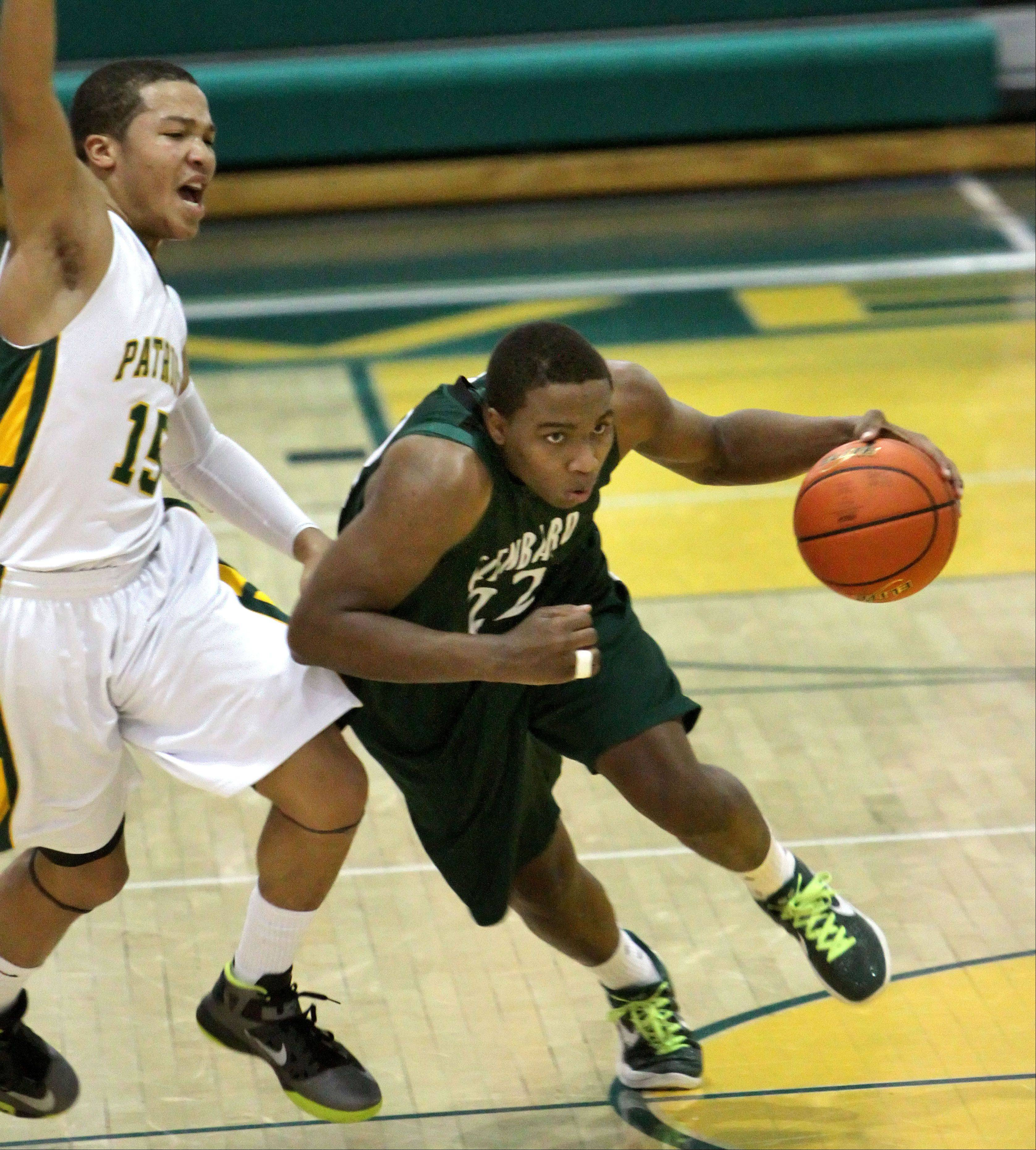 Glenbard West�s Dikiria Washington, right, drives on Stevenson�s Jalen Brunson.