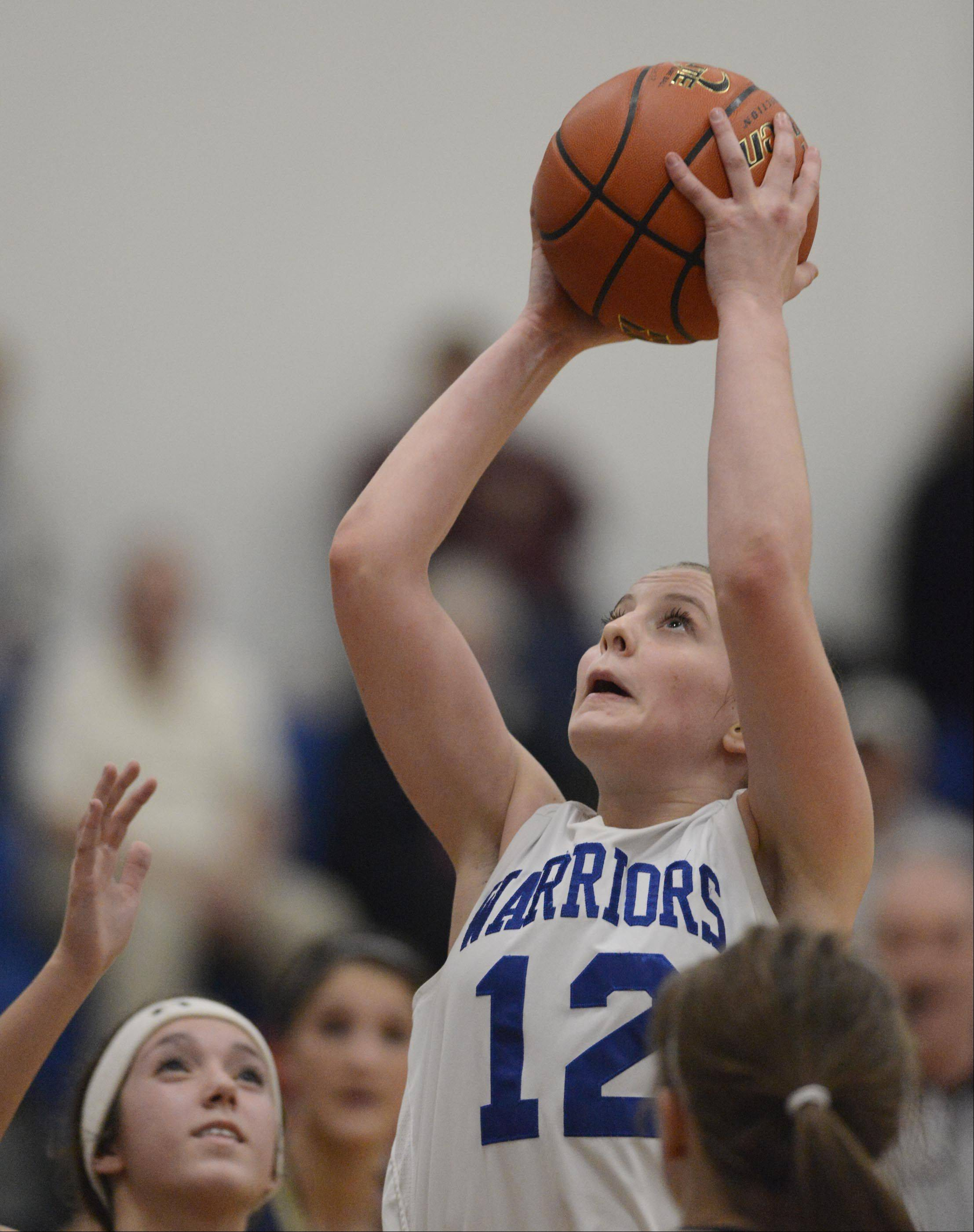 Westminster Christian�s Maddie Versluys goes up for a score against Ottawa Marquette Academy Tuesday in Elgin.