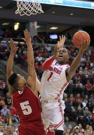 Deshaun Thomas scored 25 points, including 10 during a game-breaking 15-0 second-half run, to lead No. 11 Ohio State past Wisconsin 58-49 on Tuesday night.The leading scorer in the Big Ten, Thomas took over the game as both teams tried to gain leverage in a typically physical matchup between them.