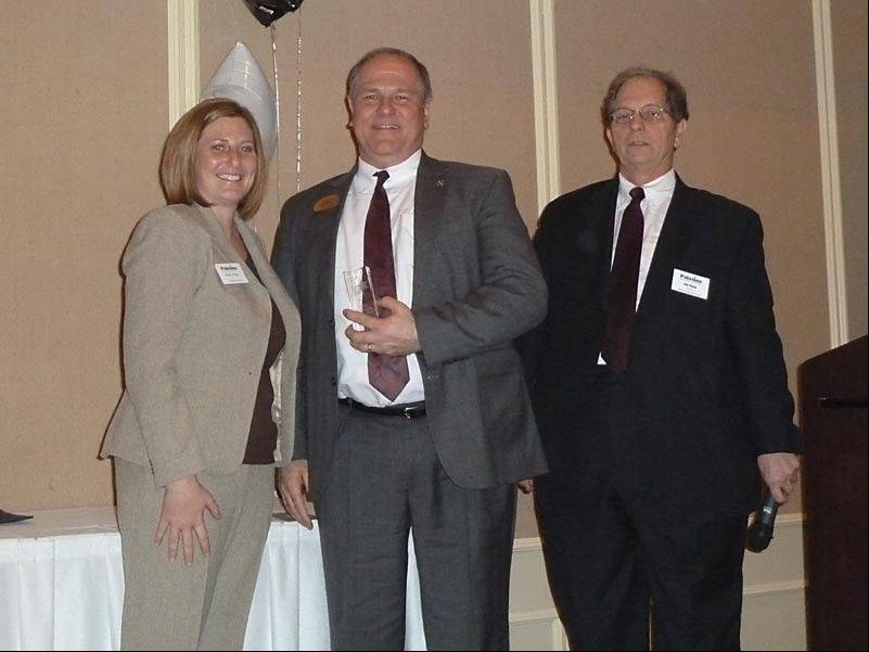 Volunteer of the Year Hank Sobotka, center, with chamber Director Mindy Phillips and board president Jim McLin.