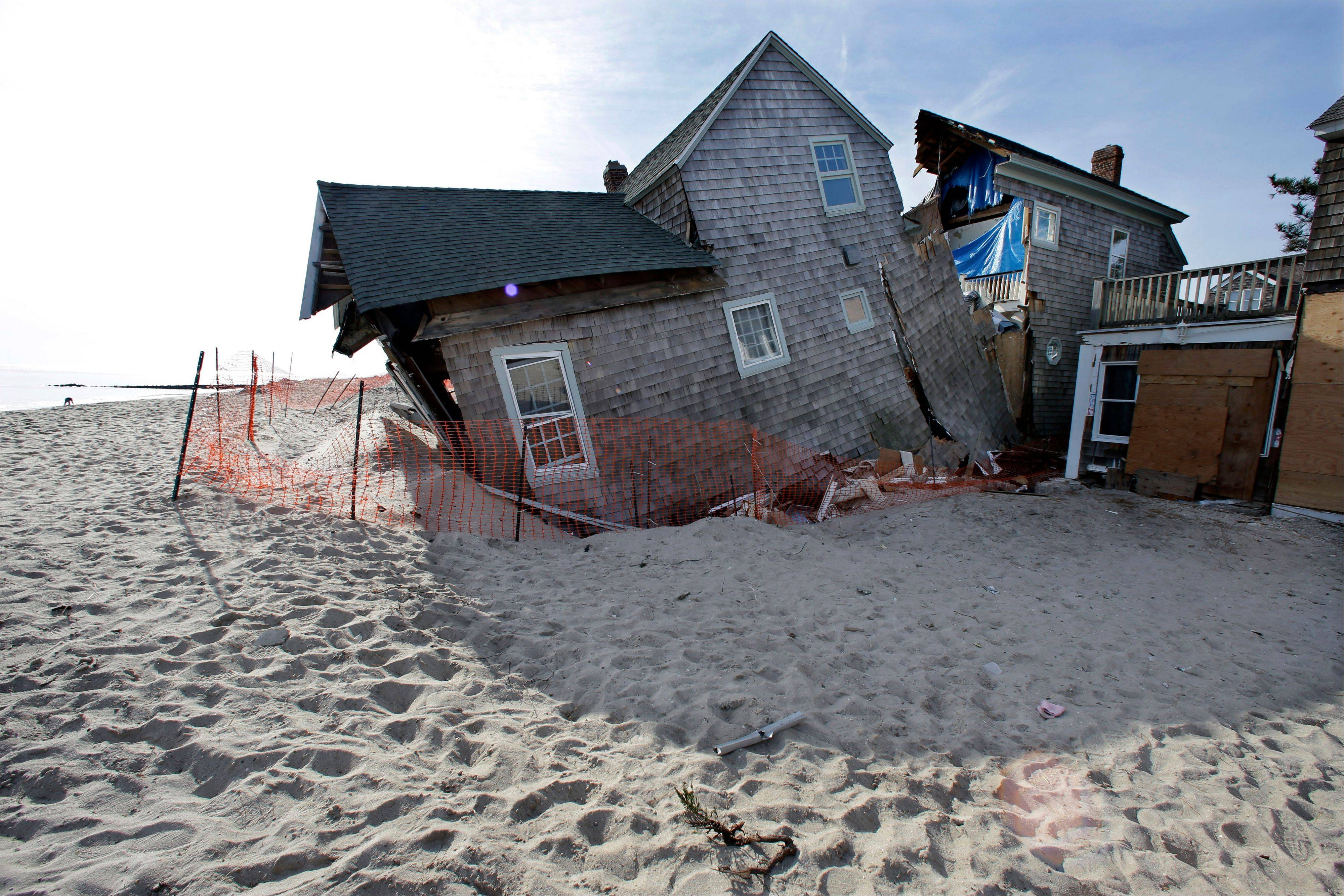 A beach front home that was severely damaged by Superstorm Sandy in the sand in Bay Head, N.J.