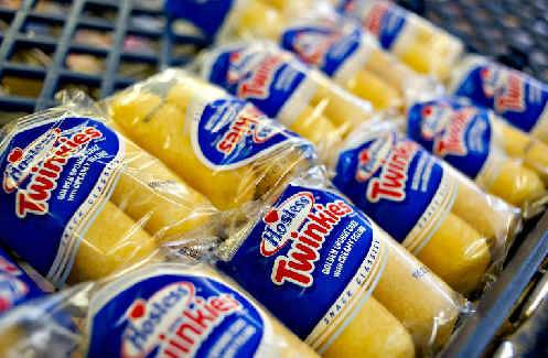 Hostess Brands Inc. Twinkies snacks sit on a shelf inside the company's outlet store in Peoria.