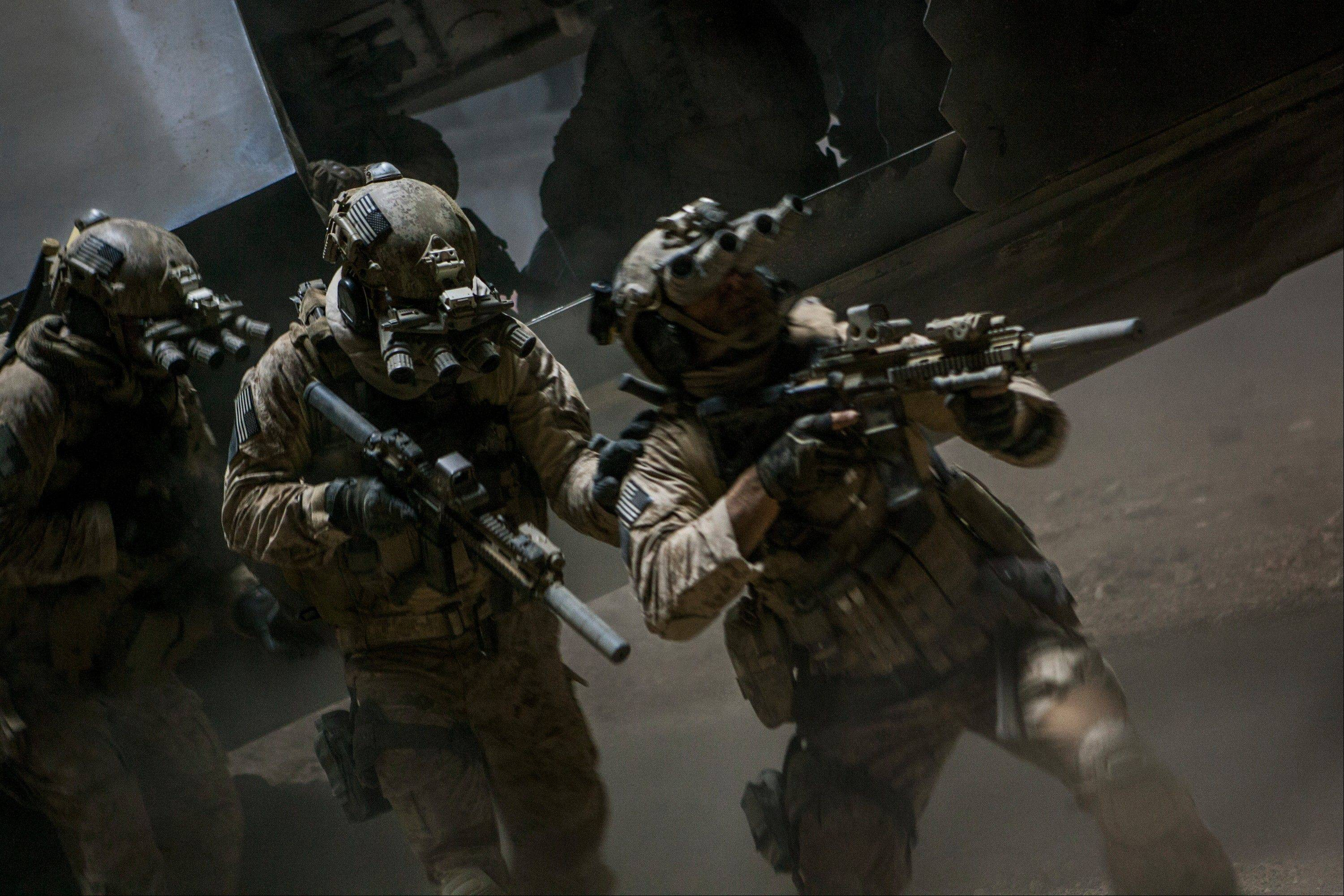 "Navy SEALs raid Osama bin Laden's suspected compound in Kathryn Bigelow's fact-based thriller ""Zero Dark Thirty."" Mount Prospect native Alex Ullrich created some of the sound effects for the movie."