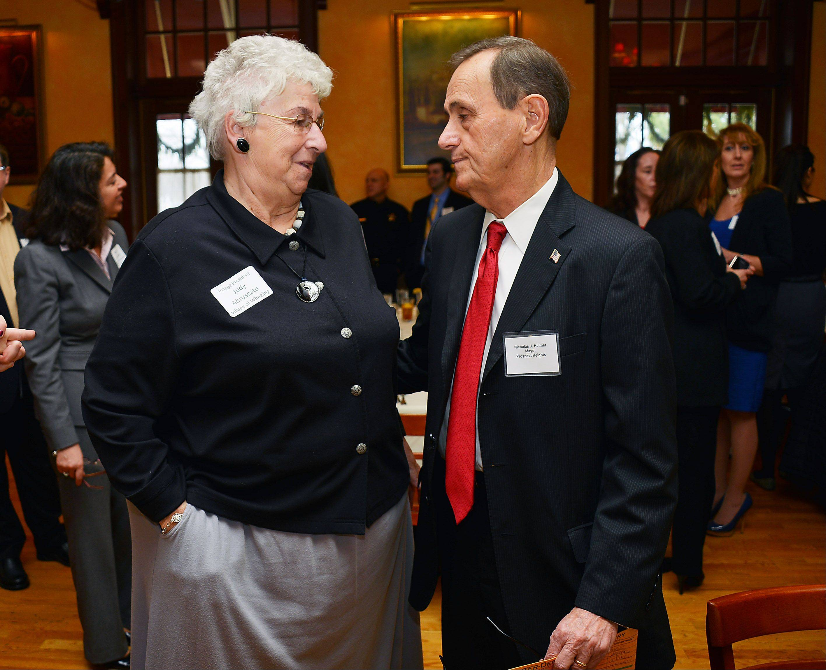 Judy Abruscato, Wheeling village president, and Nick Helmer, mayor of Prospect Heights, chat before talking to the Wheeling/Prospect Heights Area Chamber of Commerce. Both painted optimistic pictures of their local economies.