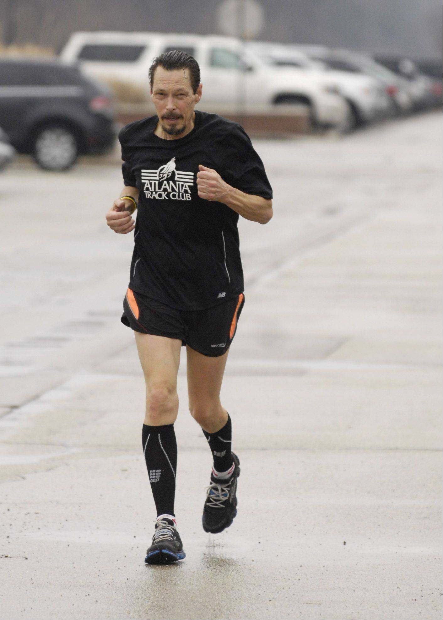 With the temperature of 59 degrees at the time, Drew Pearce of Aurora who was running with the Glen Ellyn Runners Club, was able to run in just a pair of shorts and tee shirt, Tuesday