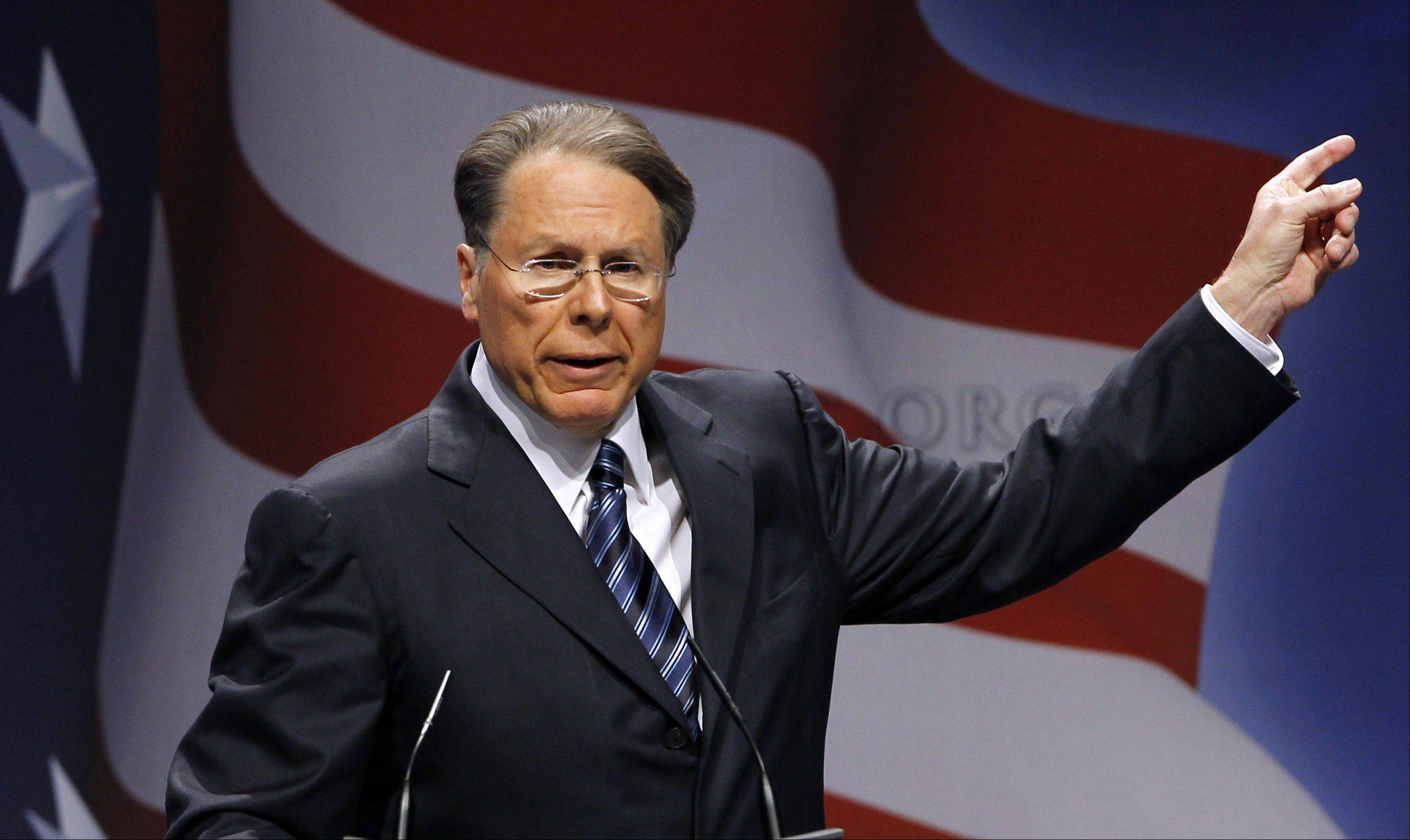 National Rifle Association Executive Vice President Wayne LaPierre said the country must focus on boosting security at schools, enforcing existing gun laws and taking more steps to deny guns to people with mental illnesses.