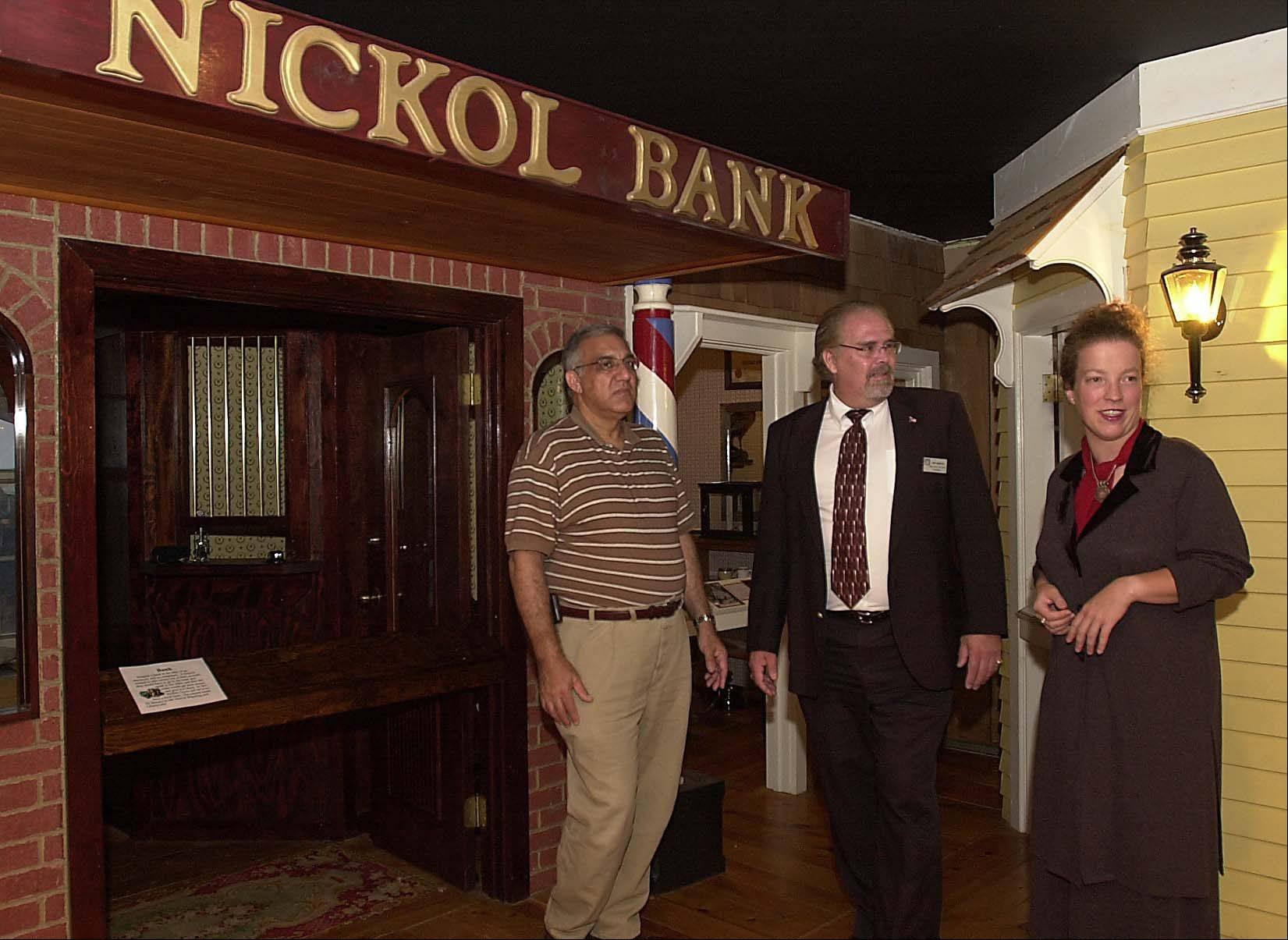 Then Buffalo Grove Village President Elliott Hartstein, left, and Park District Board President Don Hedlund are given a personal tour of the Raupp Museum by Curator Debbie Fandrei after an expansion is completed in September 2002.